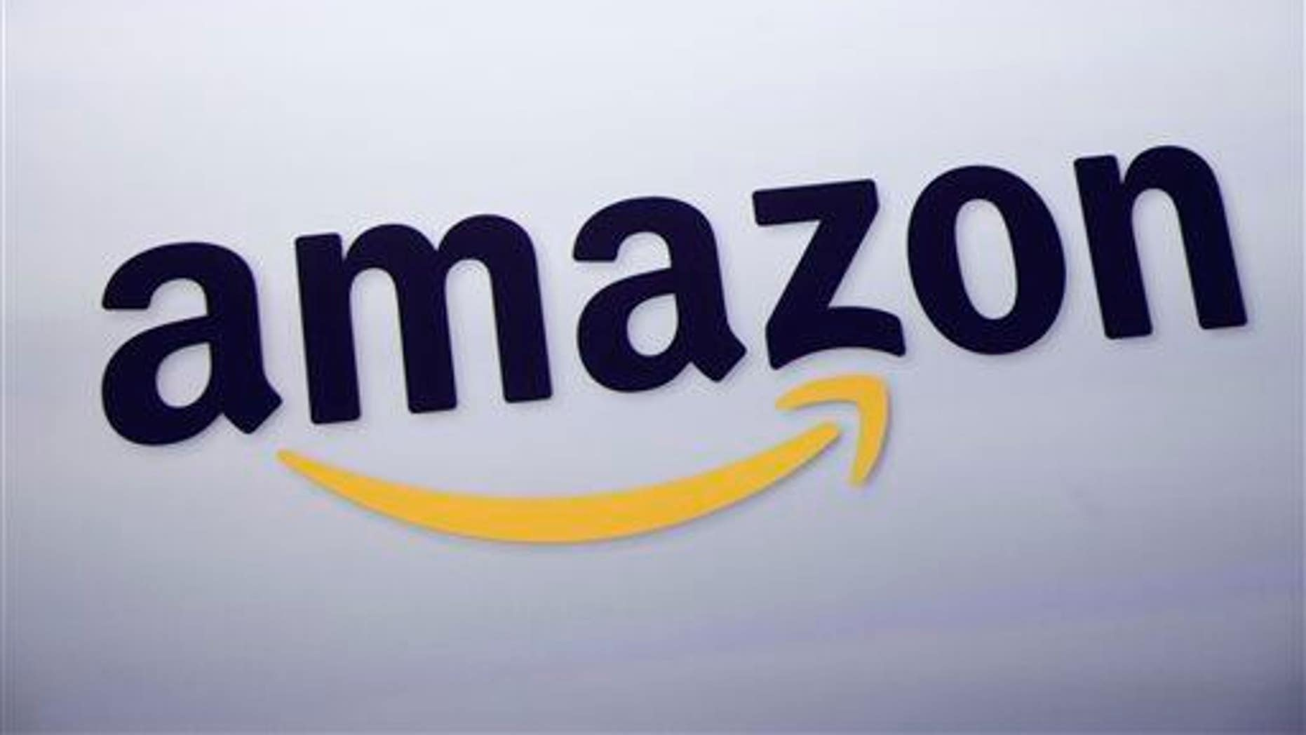 The Amazon.com logo is displayed at a news conference in New York.