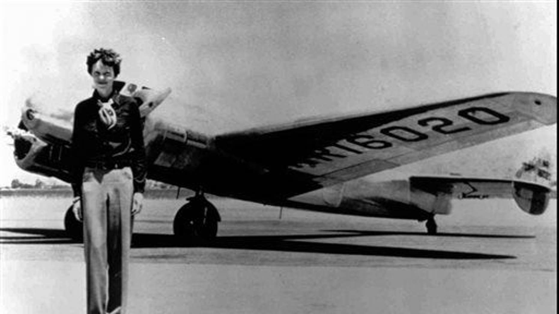 In this undated file photo, Amelia Earhart stands next to a Lockheed Electra 10E, before her last flight in 1937 from Oakland, Calif., bound for Honolulu on the first leg of her record-setting attempt to circumnavigate the world westward along the Equator.