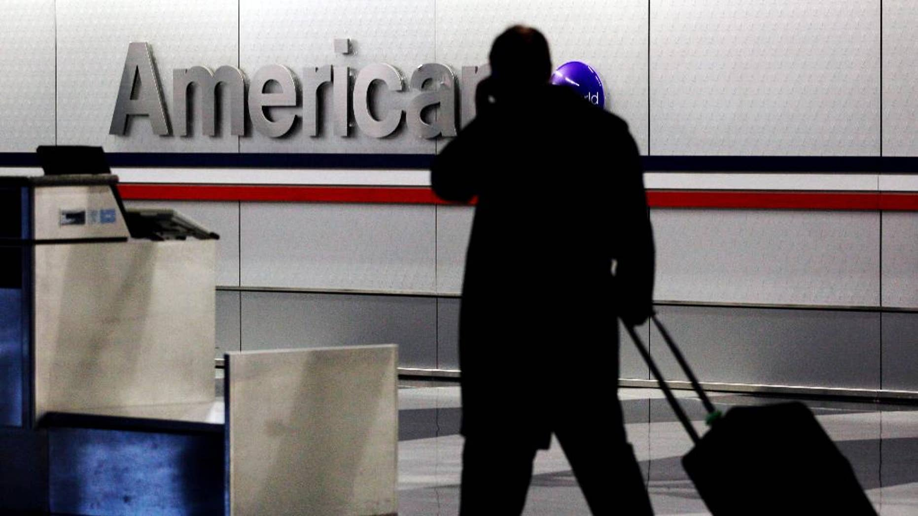 American and US Airways announced changes to their policies on checked-bag fees and redeeming miles for free flights.