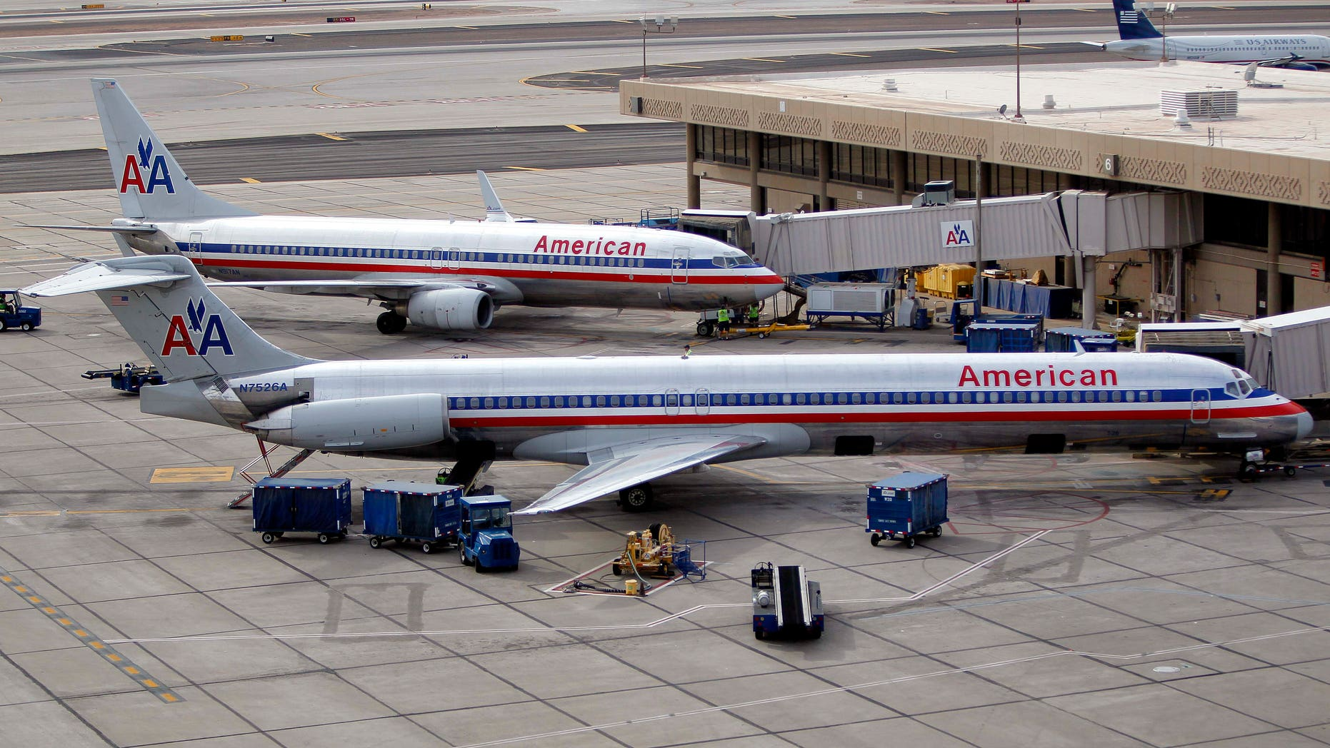 November 29: American Airlines' jets sit at the gate at Sky Harbor International Airport in Phoenix. American Airlines and its parent company are filing for Chapter 11 bankruptcy protection as they seek to cut costs and unload massive debt built up by years of high jet fuel prices and labor struggles.