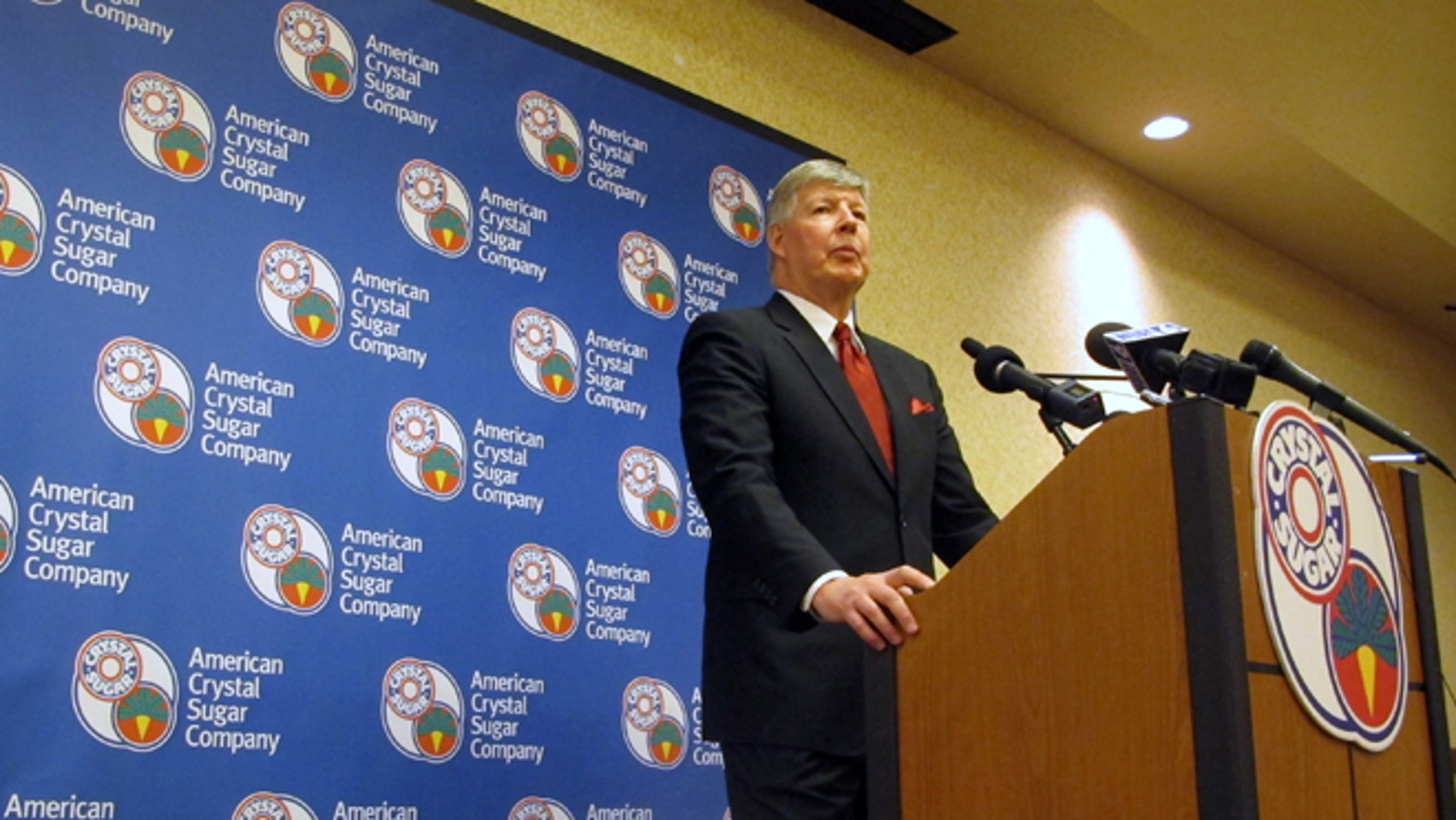 American Crystal Sugar Co. CEO David Berg speaks at a news conference during the cooperative's annual meeting in Fargo, N.D. on Thursday, Dec. 3, 2015. Berg says sugar prices are better than a year ago but the company is facing roadblocks from the anti-genetically modified foods movement and Texas Sen. Ted Cruz, who wants to do away with government assistance to sugar. (AP Photo/Dave Kolpack)