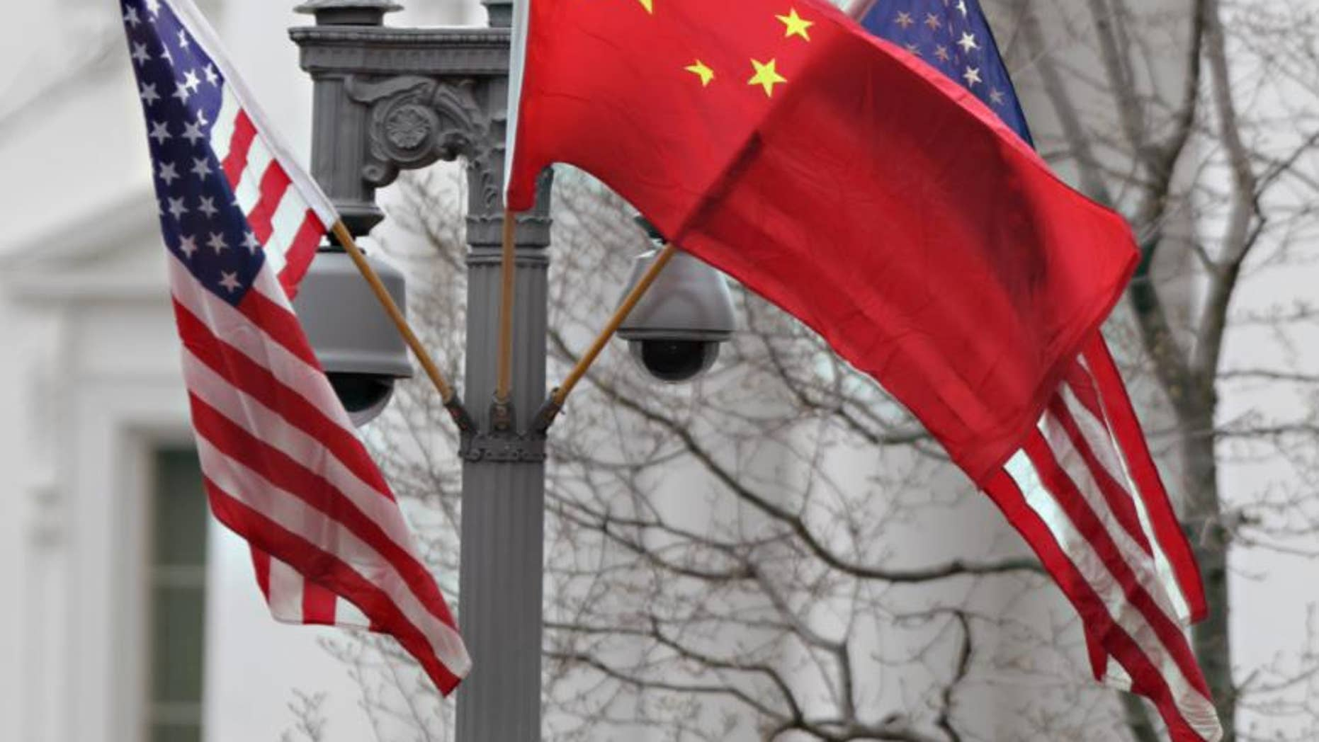 American and Chinese flags fly along Pennsylvania Avenue in front of the White House in Washington, Monday, Jan. 17, 2011. On Wednesday, Chinese President Hu Jintao arrives for a state visit. (AP Photo/Carolyn Kaster)