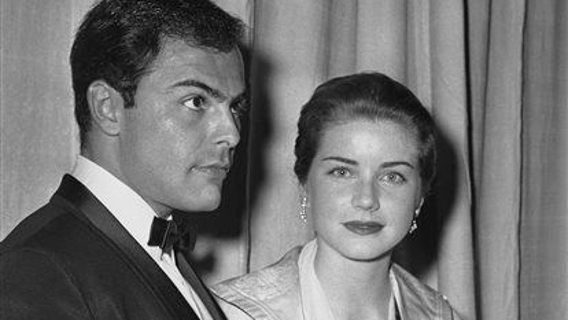 In this April 4, 1960 file photo, actor John Saxon and actress Dolores Hart arrive at Pantages Theater in Hollywood, Calif.