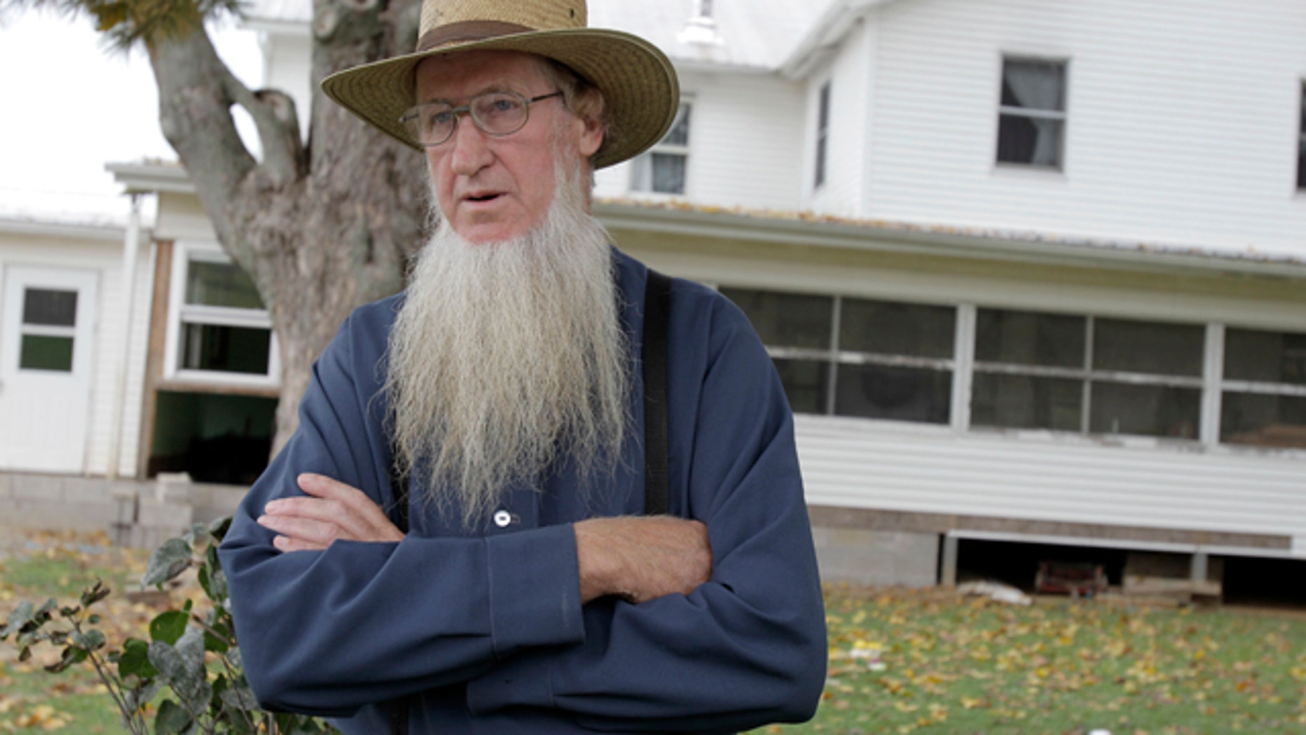 FILE 2011: Sam Mullet stands in front of his Bergholz, Ohio home. Mullet is the alleged ringleader in beard-cutting attacks.