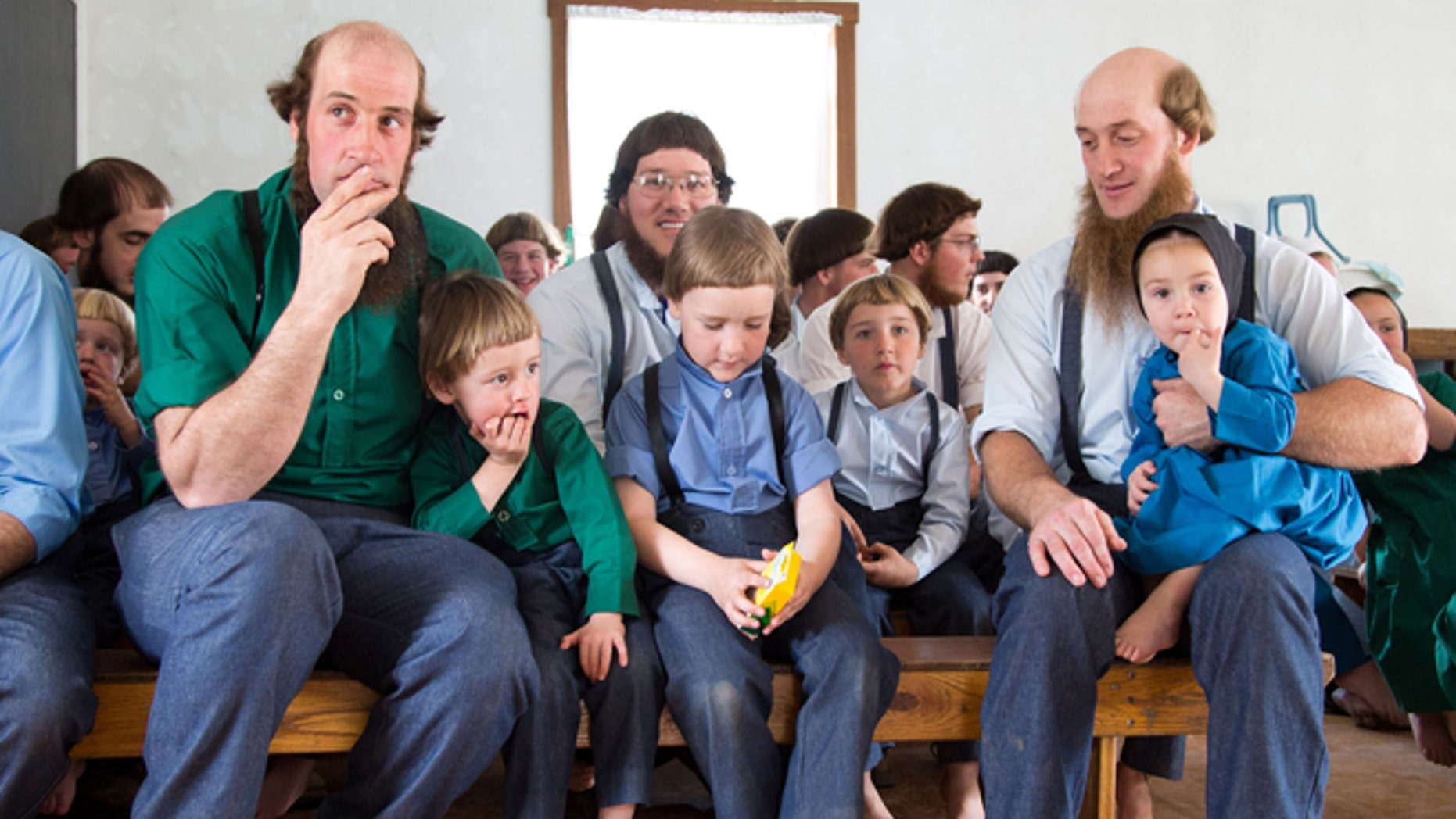April 9: Amish men fill-up the school house to listen to their children sing during the final day of class in Bergholz, Ohio.