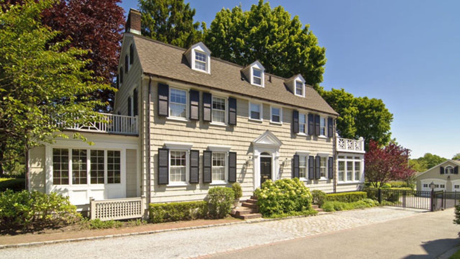 """In this photo provided by Daniel Gale Sotheby's International Realty, the house made famous in the 1979 film """"The Amityville Horror"""" is shown in this May 20, 2010 file photo taken in Amityville, N.Y.. Since the house is under contract the current owner of the New York house is holding a moving sale Saturday Aug. 21, 2010."""