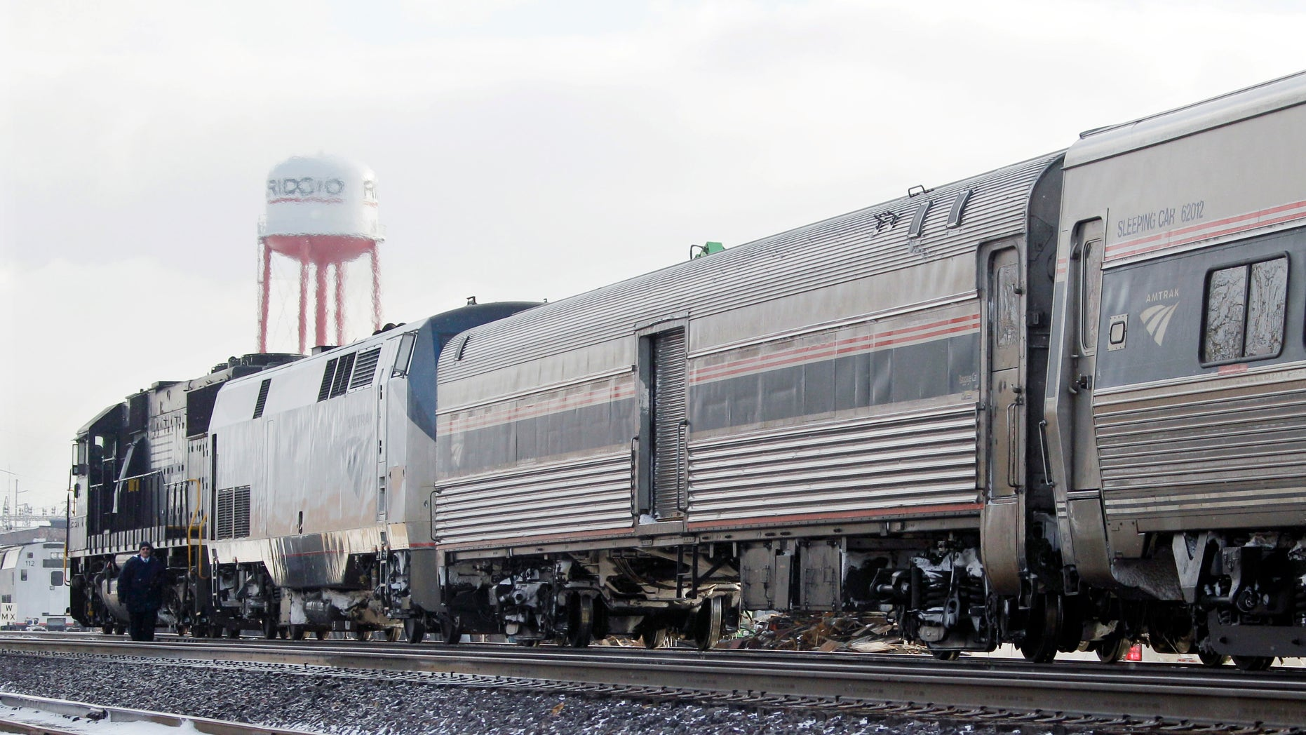 Dec. 15: A Norfolk and Southern engine hooked to an Amtrak passenger train waits on a siding in Elyria, Ohio. The lead engine of the Chicago-to-New York Lake Shore Limited Amtrak train caught fire earlier in the morning forcing evacuation of 128 passengers and three train crew.