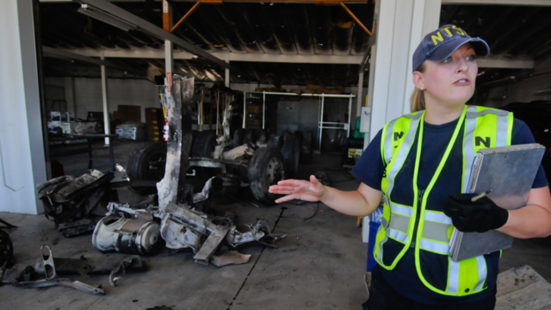 June 27: Jennifer Morrison, investigator from the NTSB, briefs the media on the wreckage recovery efforts of the 2008 Peterbilt 367 truck-tractor at the Nevada Department of Transportation maintenance facility in Fallon, Nev.