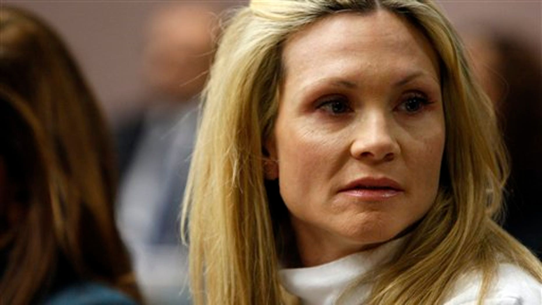 "This Nov. 27, 2012 file photo shows former ""Melrose Place"" actress Amy Locane-Bovenizer in court as the jury in her trial returns a verdict in Somerville, N.J."