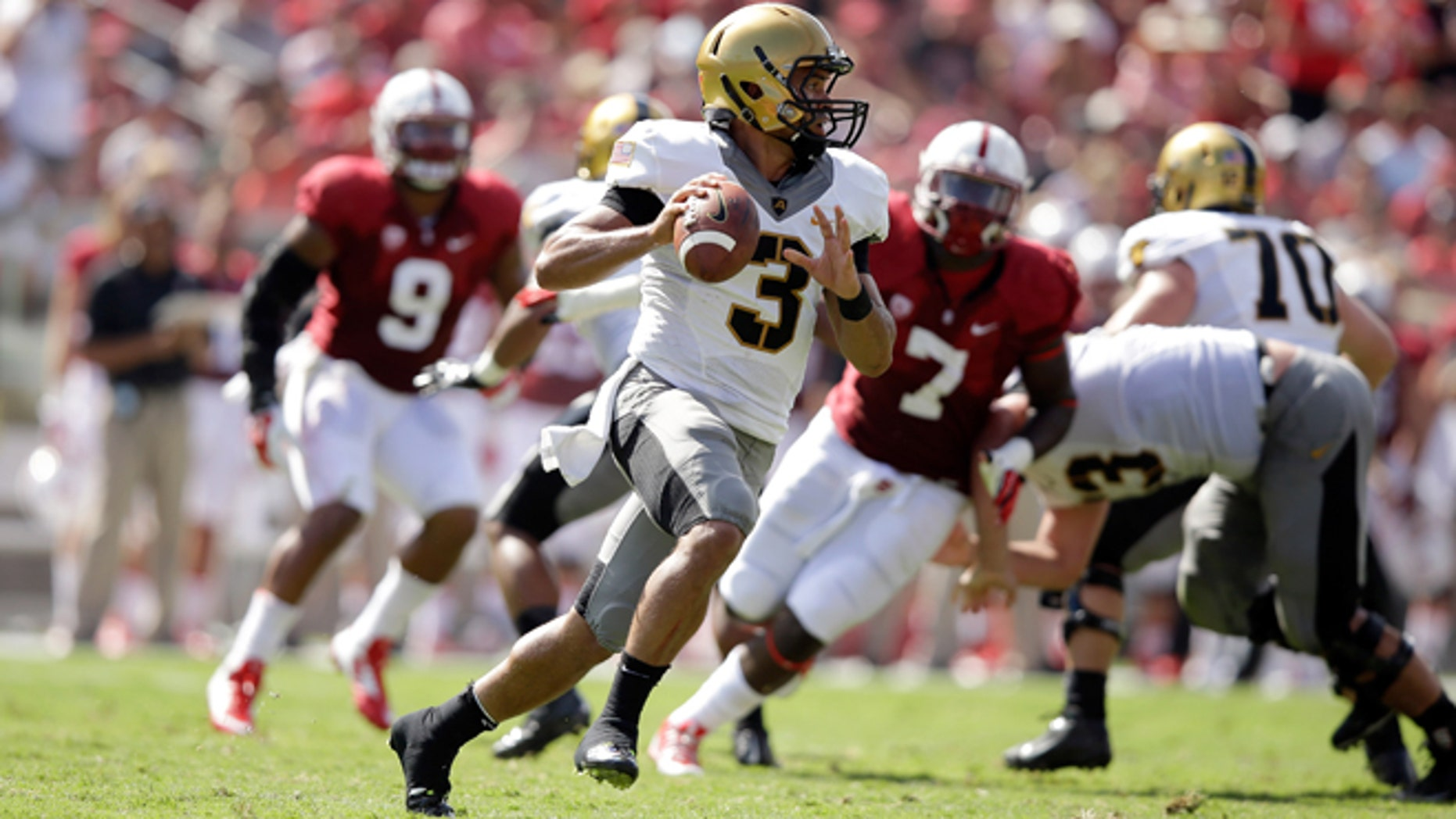PALO ALTO, CA - SEPTEMBER 13:  Angel Santiago #3 of the Army Black Knights looks to pass the ball against the Stanford Cardinal at Stanford Stadium on September 13, 2014 in Palo Alto, California.  (Photo by Ezra Shaw/Getty Images)