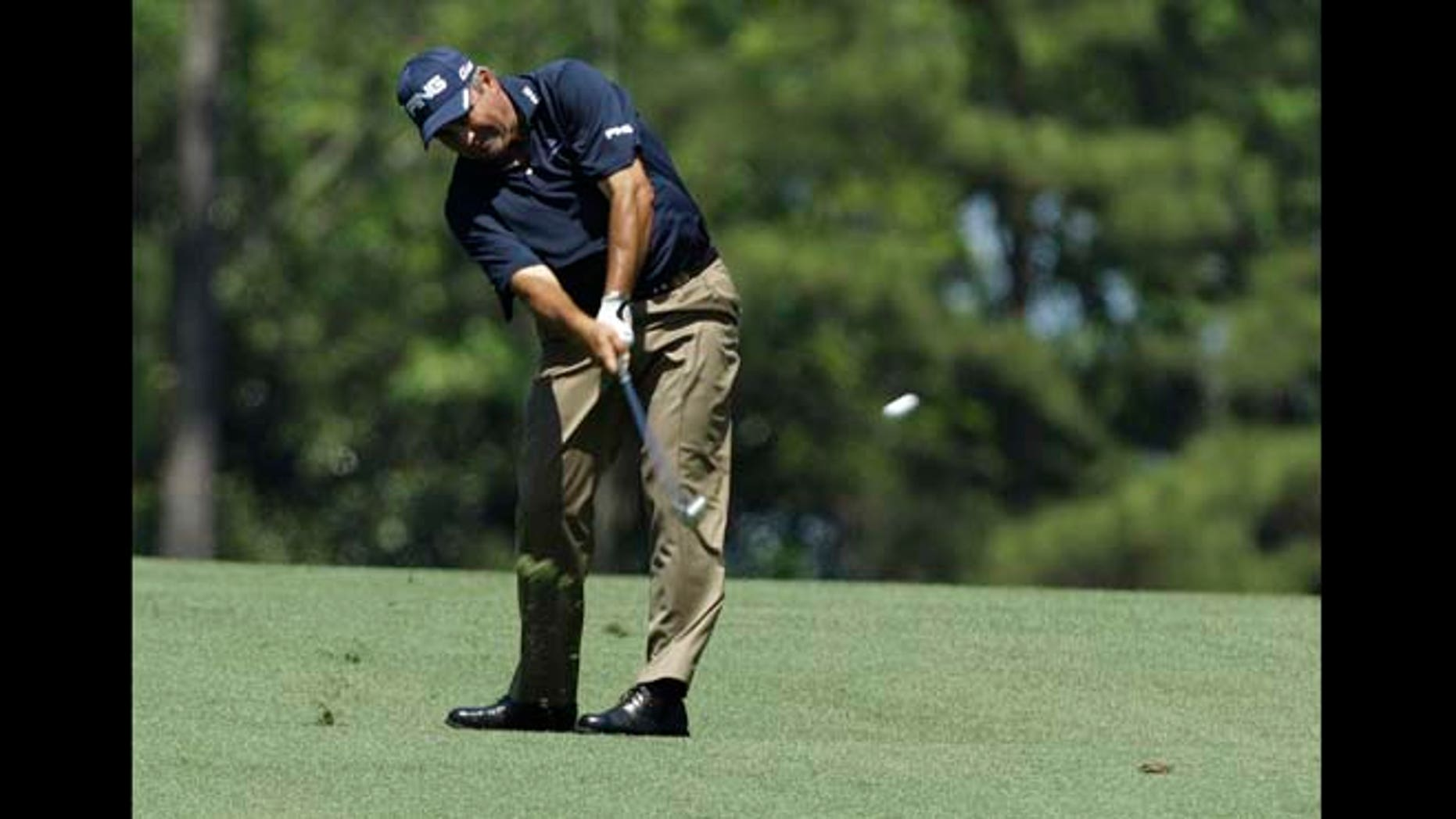Angel Cabrera, of Argentina, hits off the second fairway during a practice round for the Masters golf tournament Monday, April 2, 2012, in Augusta, Ga.
