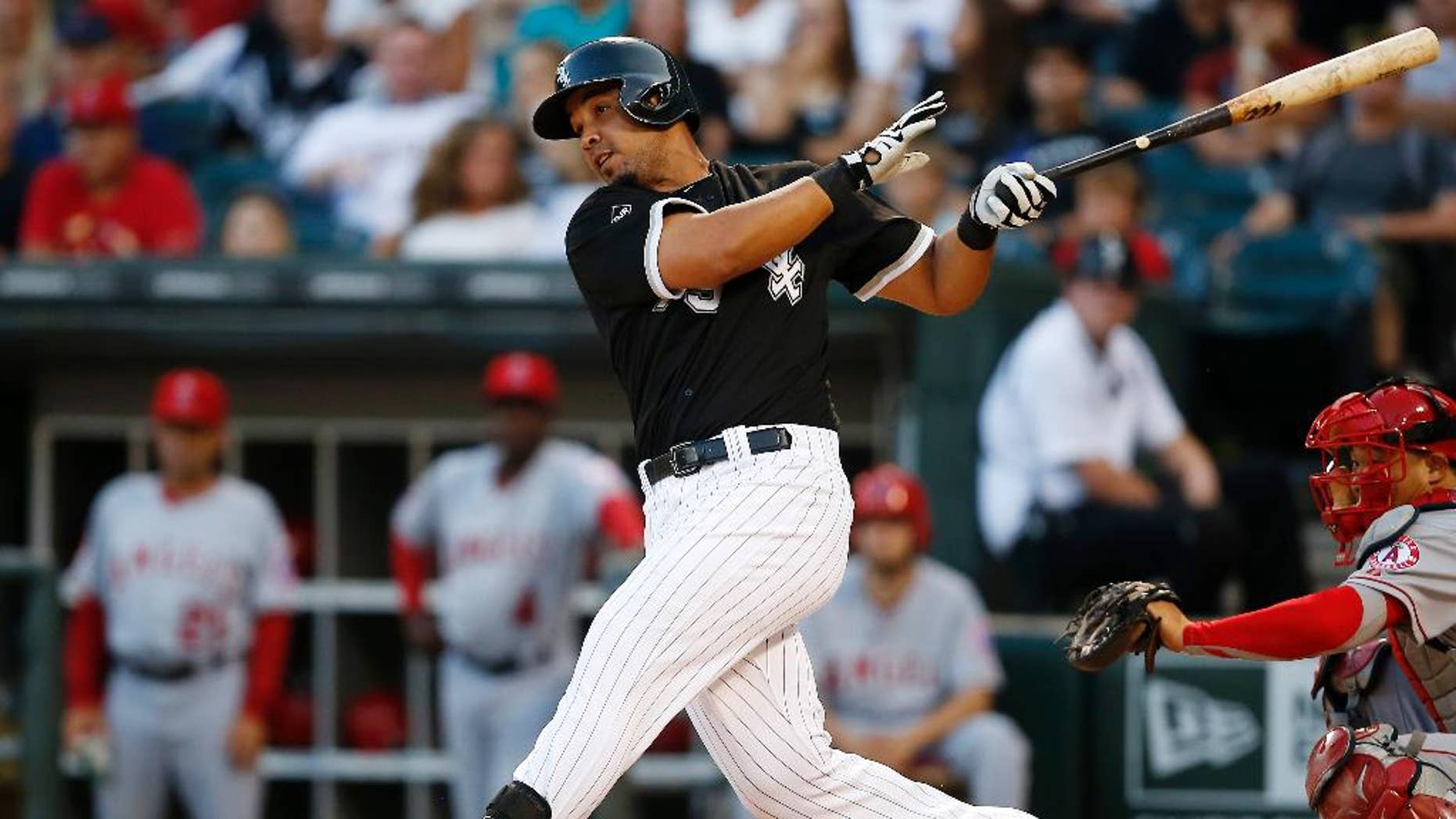 Chicago White Sox's Jose Abreu hits a single against the Los Angeles Angels during the first inning of the second baseball game of a double header on Tuesday, July 1, 2014, in Chicago. (AP Photo/Andrew A. Nelles)