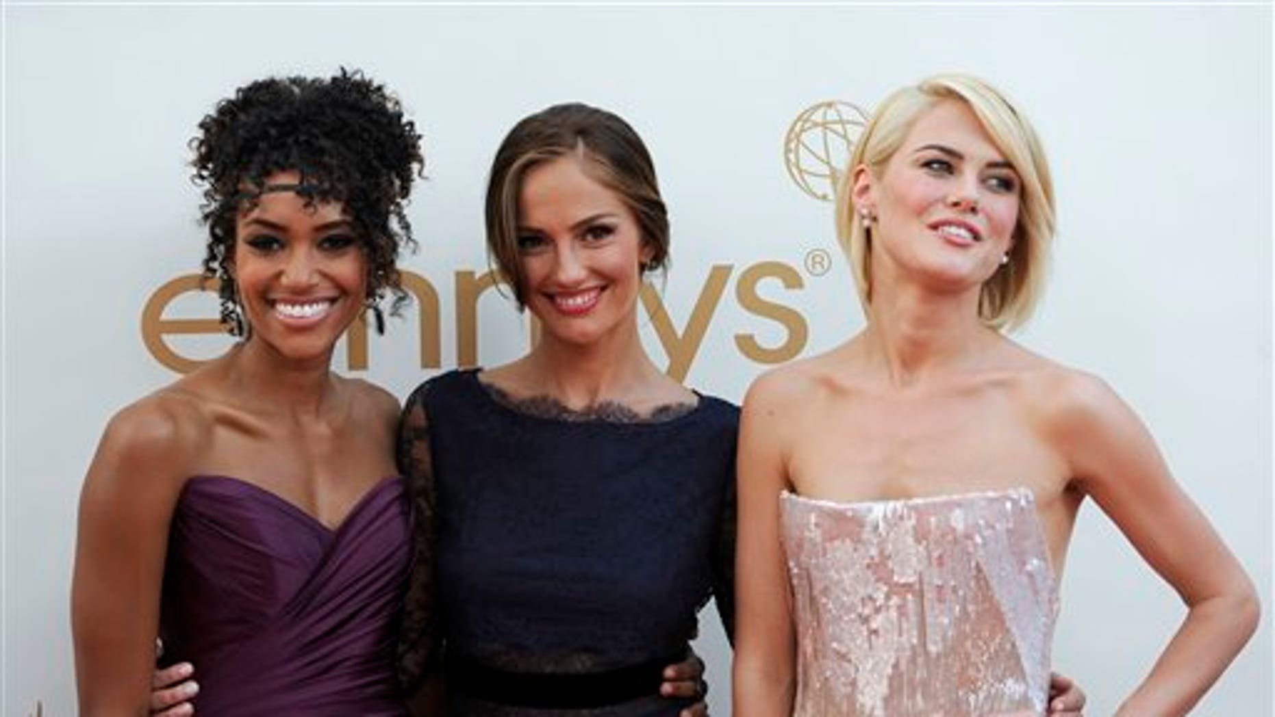 Sept. 18: From left, Annie Ilonzeh,Minka Kelly and Rachael Taylor, of the new Charlie's Angels, arrive at the 63rd Primetime Emmy Awards. (AP)