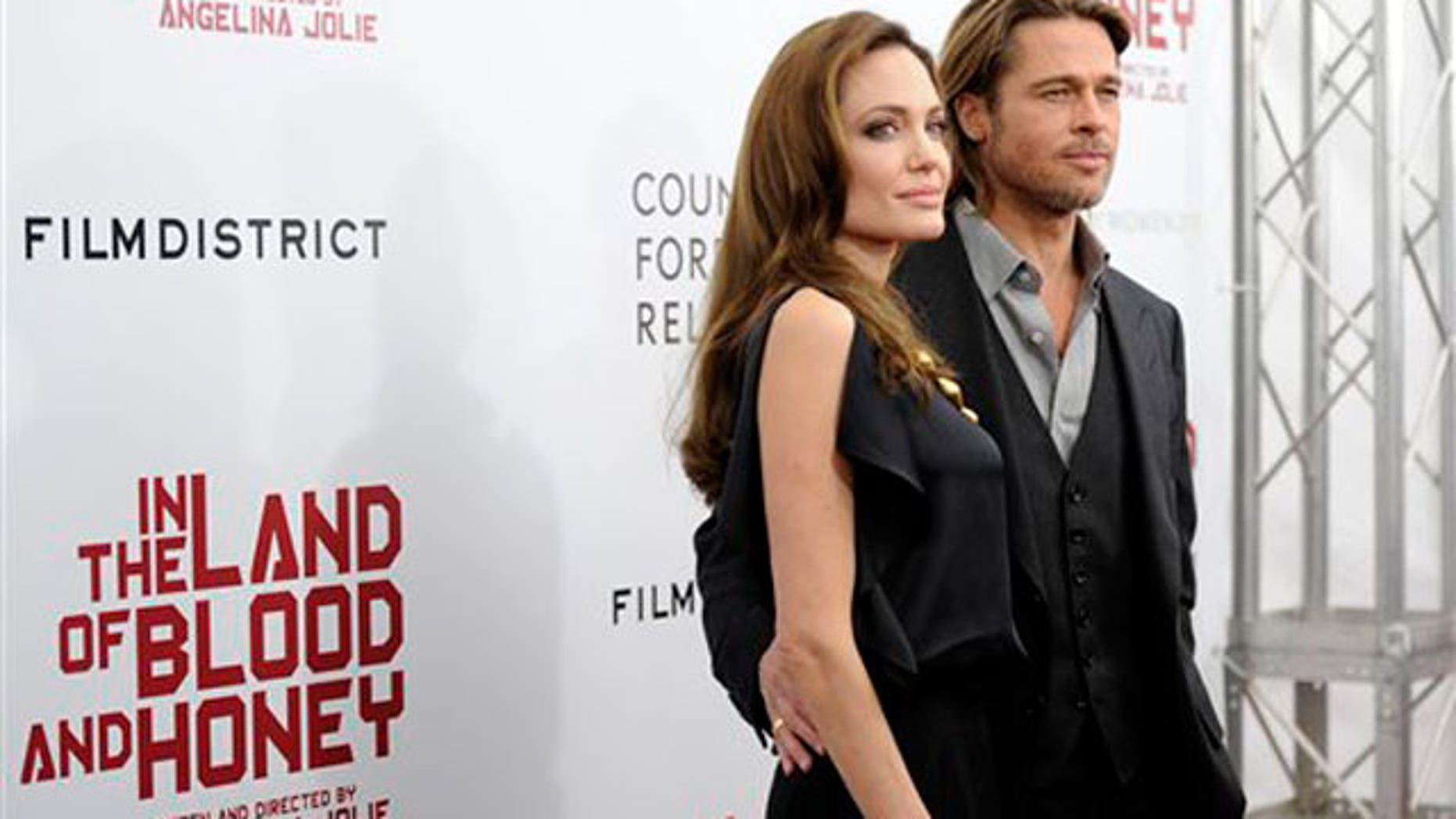 Dec. 5: Angelina Jolie and Brad Pitt at the premiere of her film 'In the Land of Blood and Honey' in New York City. (AP)