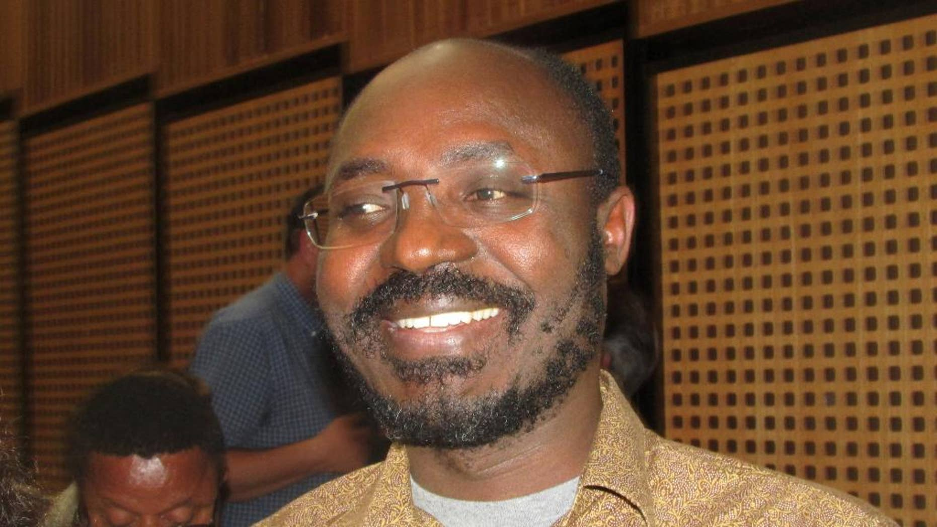 This photo taken May 11, 2014 shows Angolan journalist and human rights advocate, Rafael Marques de Morais, during a visit to Johannesburg, South Africa. Marques was last month found guilty of libel and defamation after publishing a 2011 book that alleged that a group of generals and three companies were linked to human rights abuses at diamond mines in Angola. (AP Photo/Simon Allison)