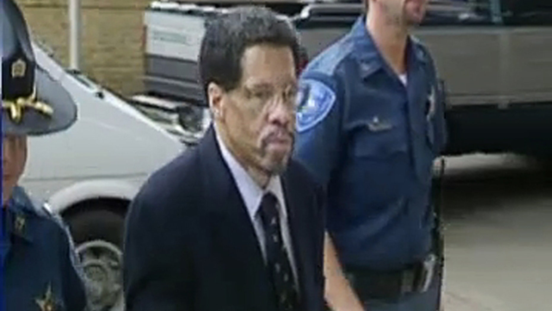 Feb. 12, 2015: In this image made from video and released by WBRZ-TV in Baton Rouge, Albert Woodfox walks into a courthouse in Louisiana. A federal appeals court on Tuesday temporarily blocked the release of Woodfox, the last of the Angola Three inmates who spent decades in isolation after forming a Black Panther Party to protest prison conditions. (WBRZ-TV via AP)