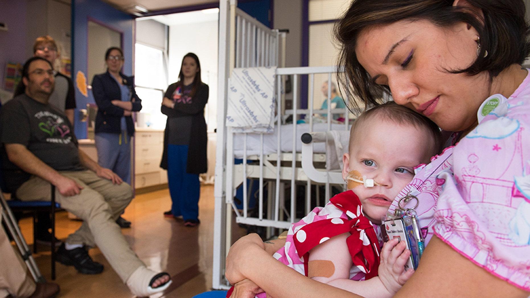Nidia Estrada, RN, nurse at Texas Children's Hospital, shares a moment with Anna.