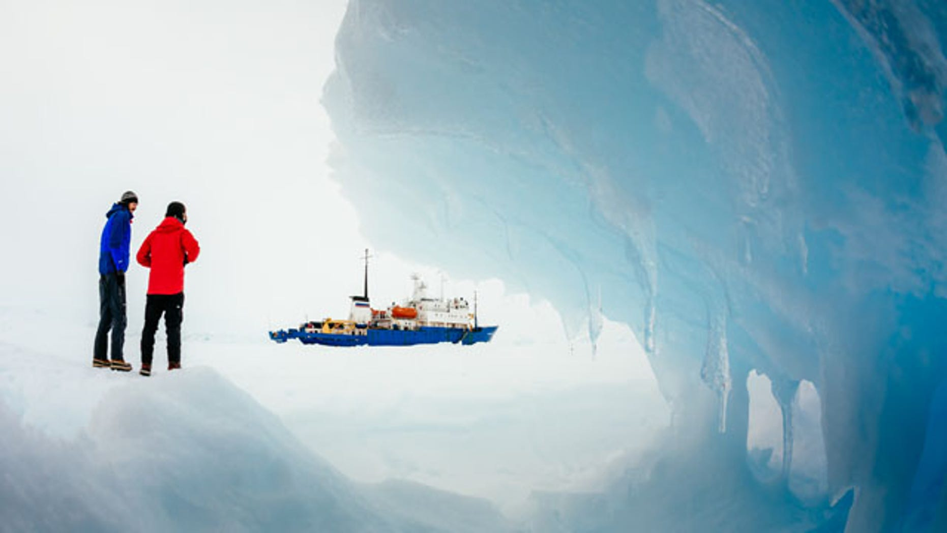December 31, 2013: Passengers from the Russian ship MV Akademik Shokalskiy trapped in the ice 1,500 nautical miles south of Hobart, Australia, walk around the ice. (AP//Australasian Antarctic Expedition/Footloose Fotography, Andrew Peacock)