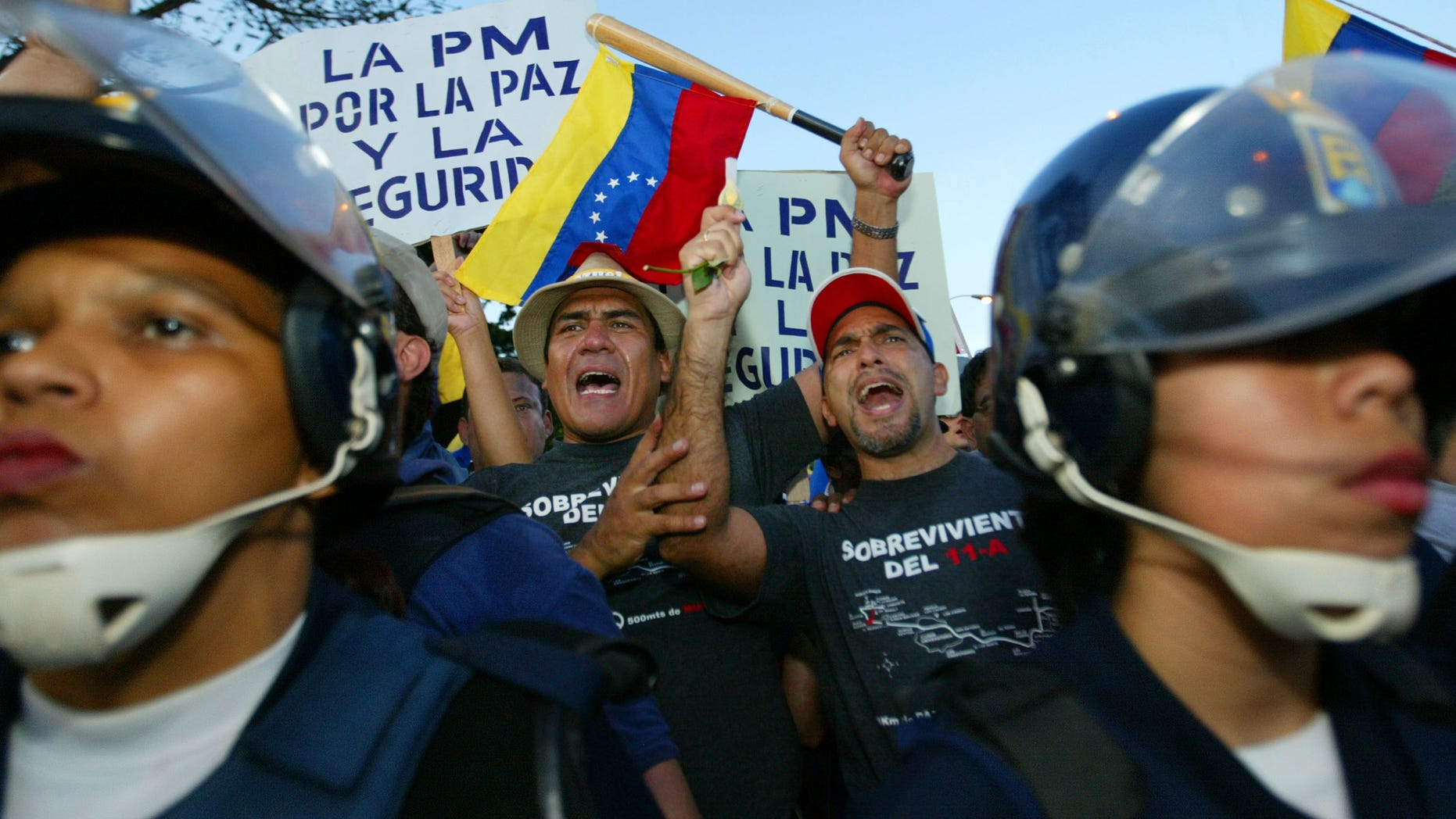 CARACAS - VENEZUELA -DECEMBER 17:  Opponents of Venezuelan President Hugo Chavez clash with police.
