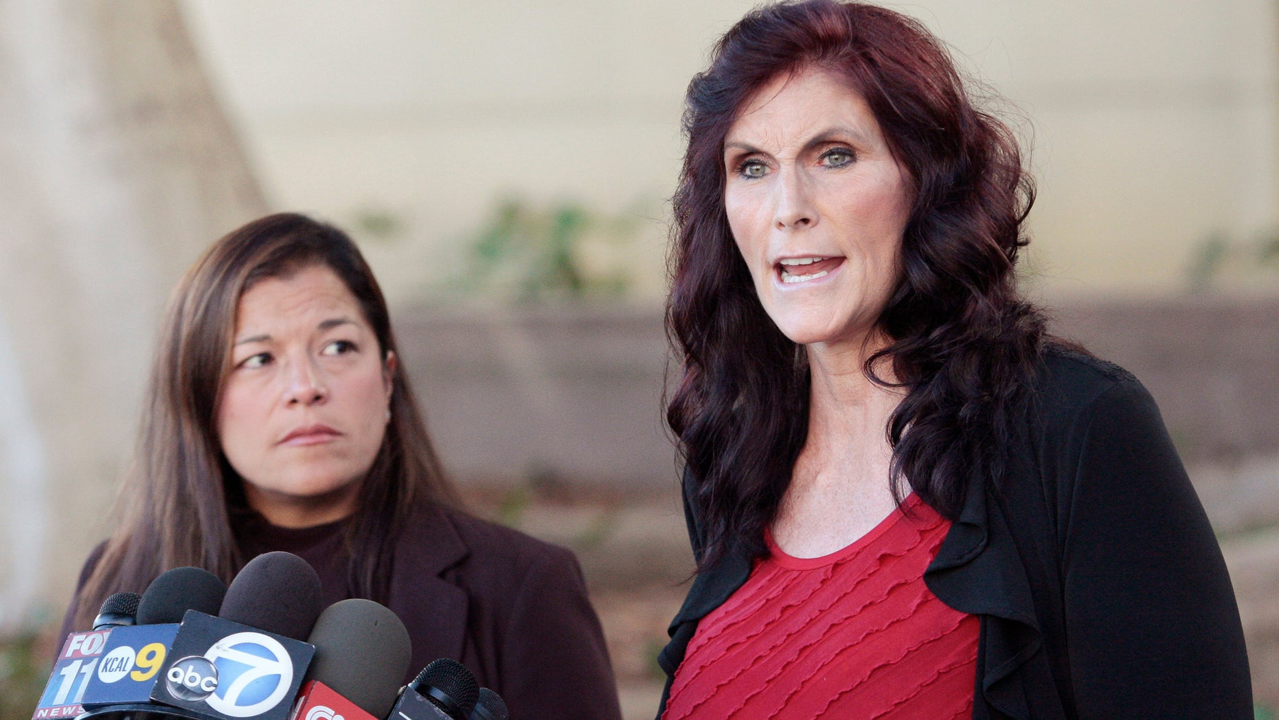 """FILE - In this Thursday, Sept. 20, 2012, file photo, Cindy Lee Garcia, one of the actresses in """"Innocence of Muslims,"""" right, and attorney M. Cris Armenta hold a news conference in Los Angeles asking a judge to issue an injunction demanding a 14-minute trailer for the film be pulled from YouTube. A federal appeals court on Monday, May 18, 2015 overturned an order for YouTube to take down the anti-Muslim film that sparked violence in the Middle East and death threats to actors. (AP Photo/Jason Redmond, File)"""