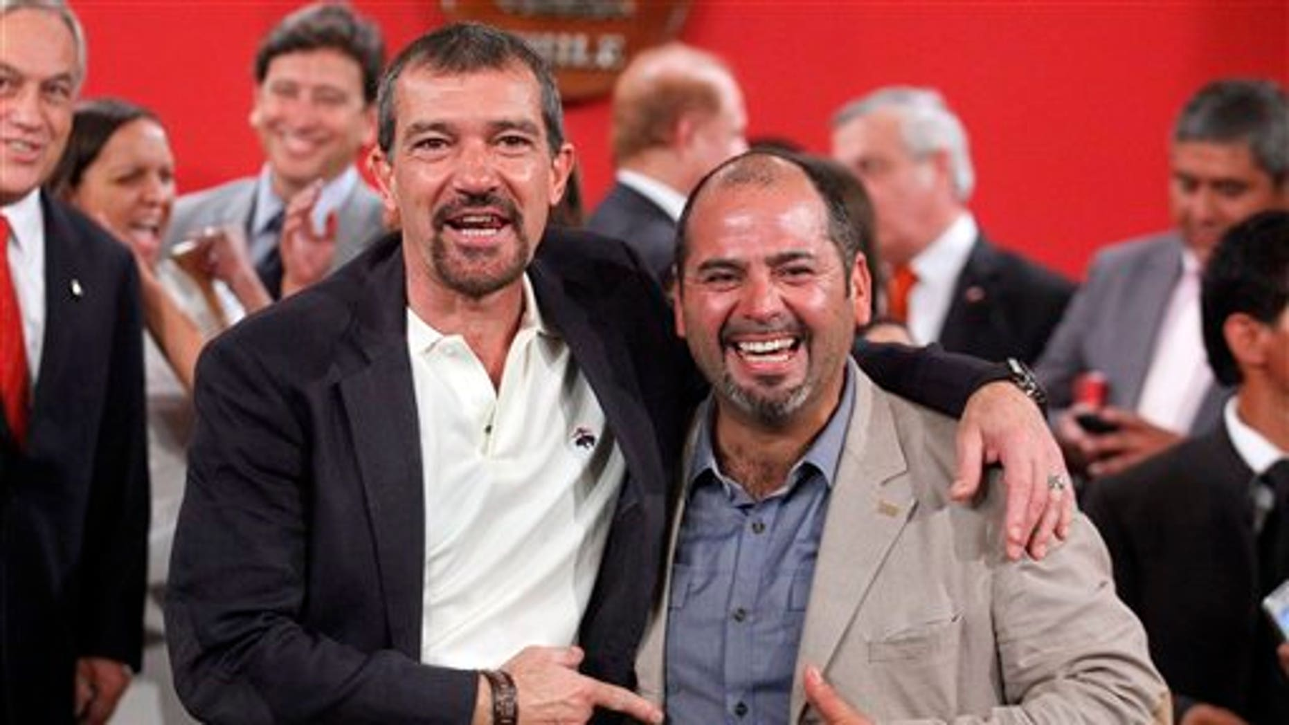 "The Spanish actor, Antonio Banderas, left, poses for photographers next to Mario Sepulveda, in Santiago, Chile, Friday Jan. 31, 2014. Sepulveda was one of the 33 miners who was trapped in a mine cave-in in Chile's Atacama desert in 2010. The Spanish star will play Sepulveda, who known as ""Super Mario,"" became the public face of the miners. (AP Photo/Luis Hidalgo)"