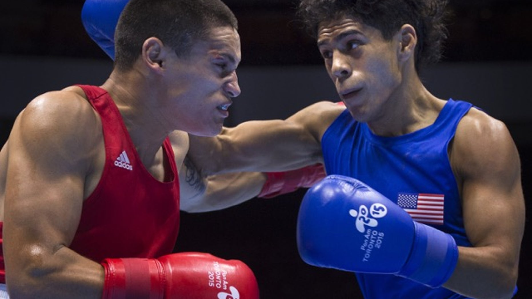 Antonio Vargas (R) in the Men's Fly (52kg) Semifinals Bout at the at the Pan American Games.