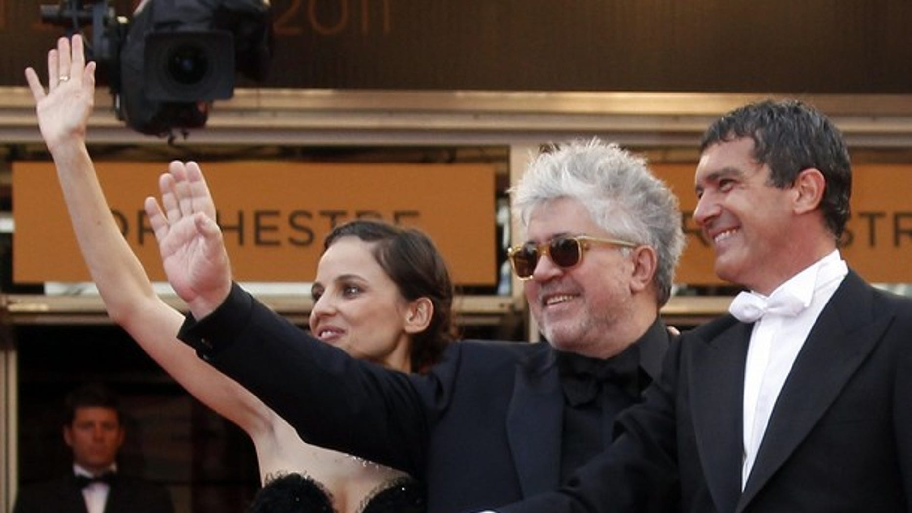 May 19: Director Pedro Almodovar (C) poses with cast members Elena Anaya (L) and  Antonio Banderas (R) on the red carpet for the screening of the film 'La Piel Que Habito,' in competition at the 64th Cannes Film Festival.