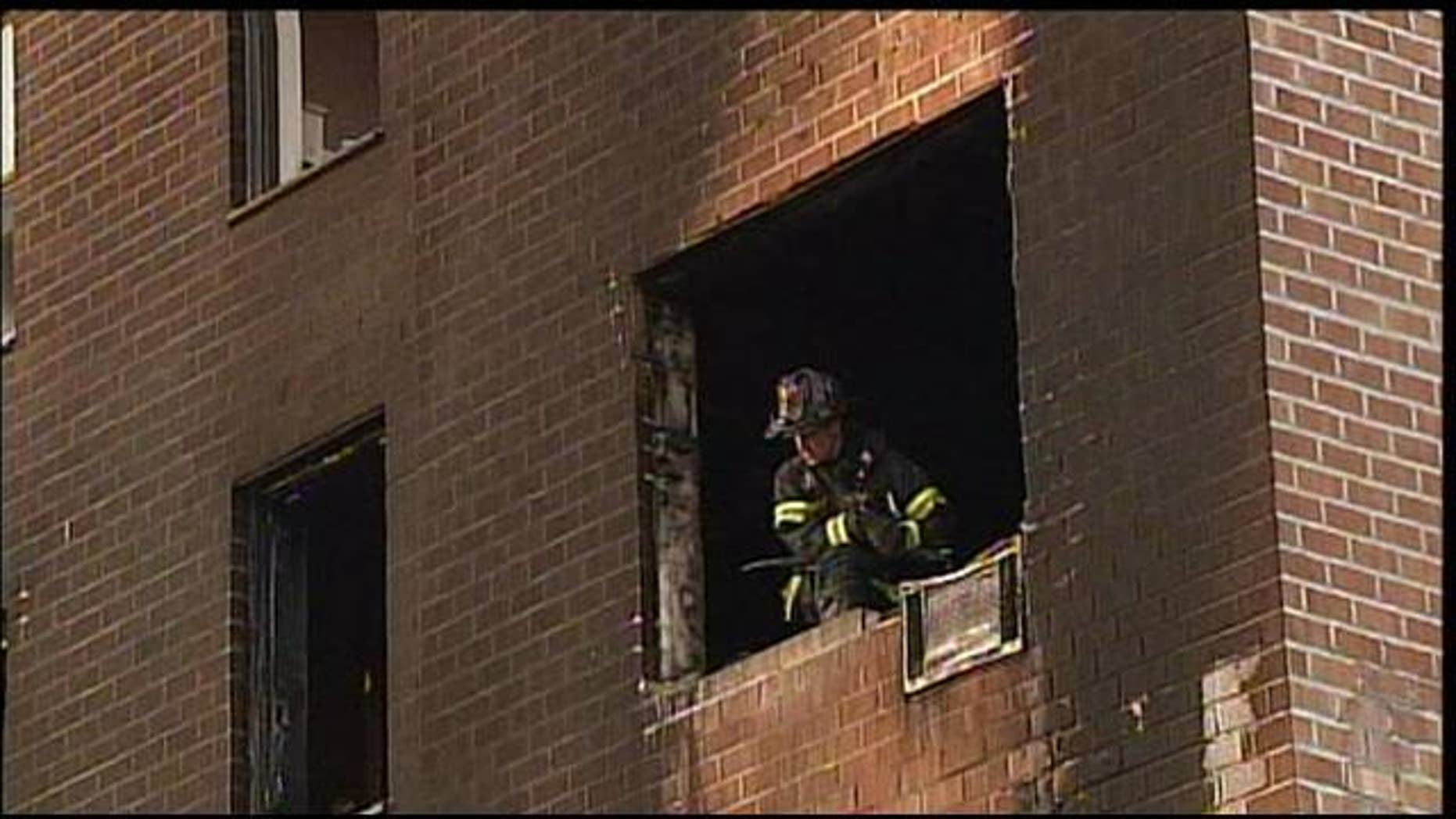 June 17, 2012: A firefighter is seen at the scene of an apartment fire in New York.