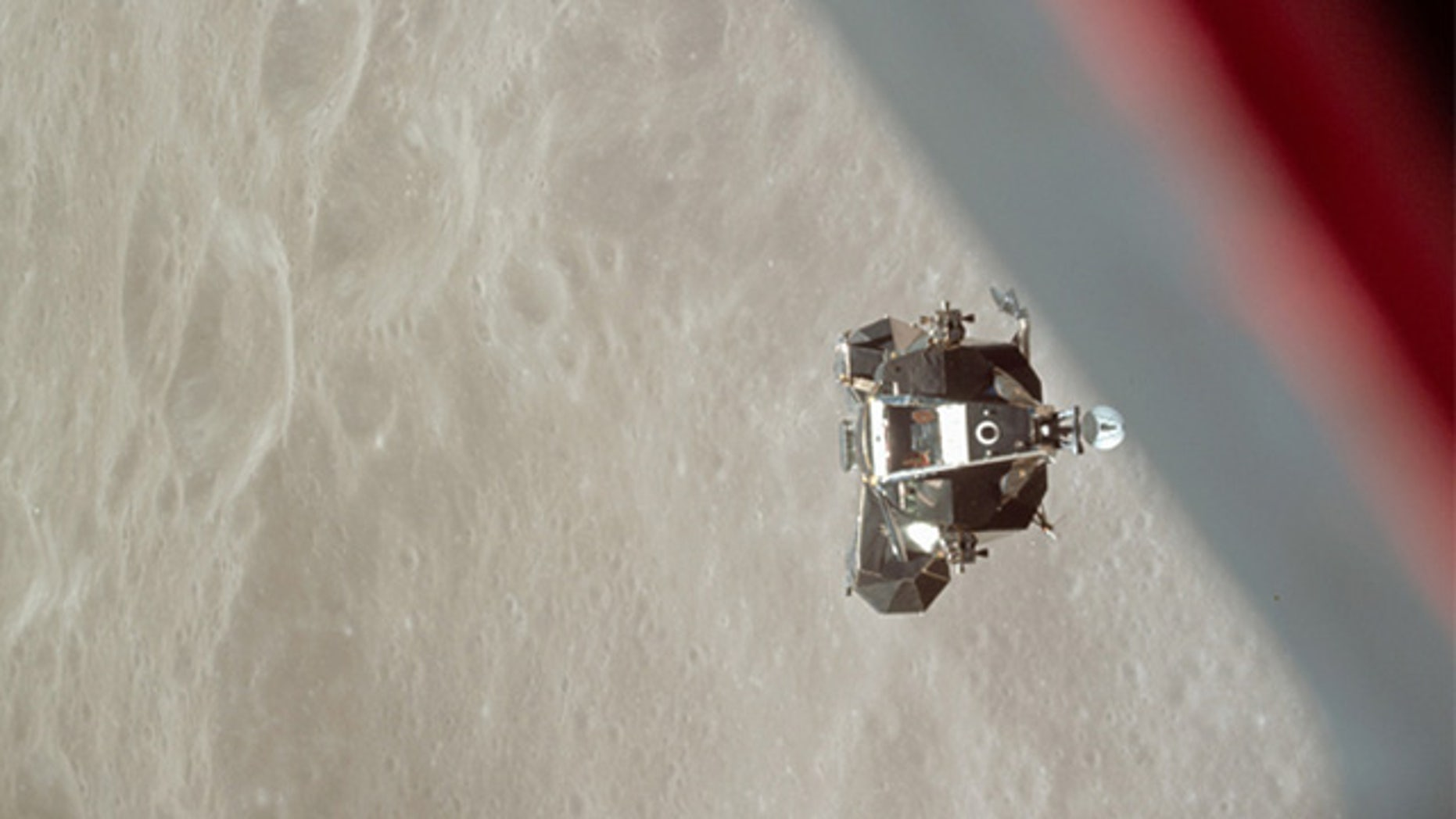 """The ascent stage of the Apollo 10 Lunar Module """"Snoopy"""" is photographed from the Command Module prior to docking in lunar orbit."""