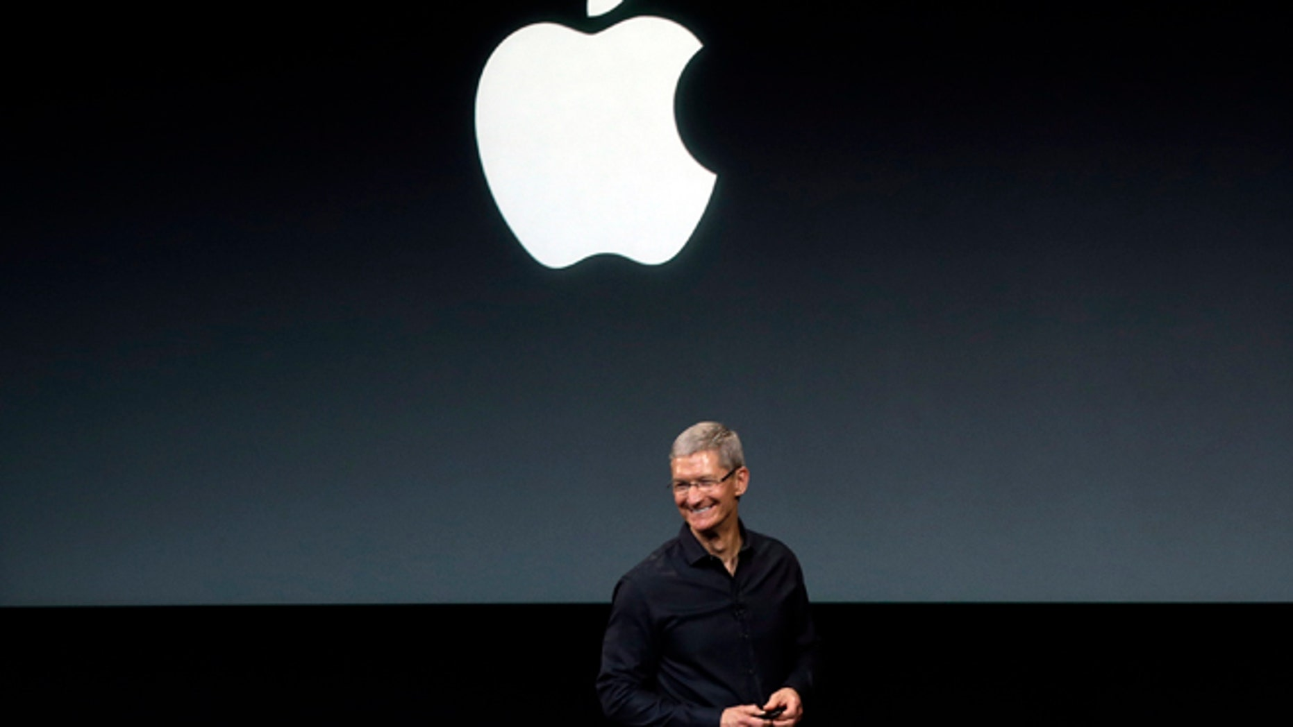 Apple CEO Tim Cook speaks on stage before a new product introduction in Cupertino, Calif., in Sept. 2013.