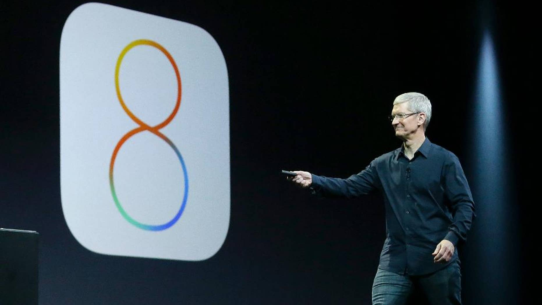 FILE - In this June 2, 2014 photo, Apple CEO Tim Cook speaks about iOS 8 at the Apple Worldwide Developers Conference in San Francisco. Apple has stopped providing an update to its new iOS 8 mobile operating software, following complaints by some users who said Wednesday, Sept. 24, 2014, that the update interferes with their ability to make phone calls. (AP Photo/Jeff Chiu, File)