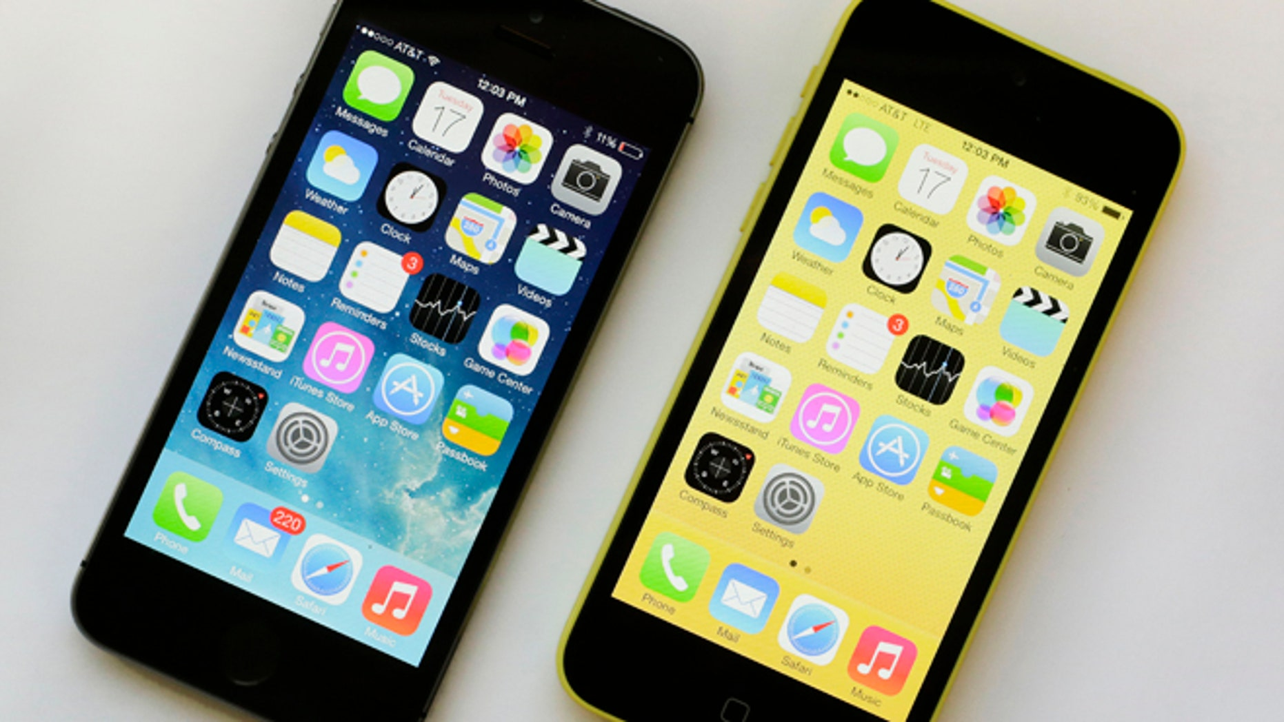 Sept. 17, 2013: The iPhone 5S, left, 5S offers a fingerprint sensor, a better camera and a faster processor, while the iPhone 5C, right, is largely last years iPhone 5 with a plastic back and a choice of five colors.