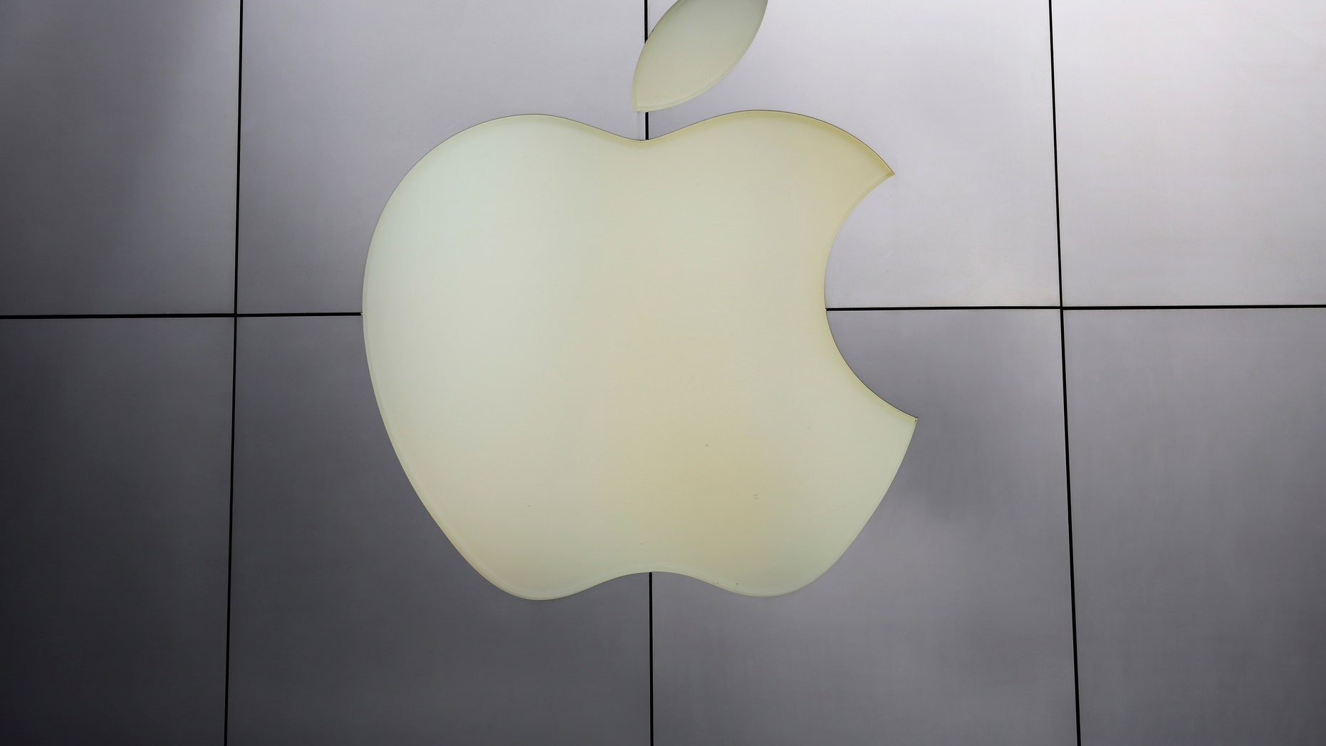 The Apple logo is pictured at its flagship retail store in San Francisco, California.