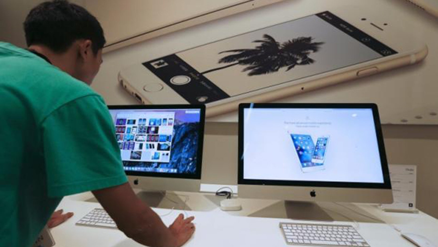Sept. 18, 2015: A sales assistant shows features of iOS 9 on an Apple iMac at an Apple reseller shop in Bangkok. (Reuters/Chaiwat Subprasom)