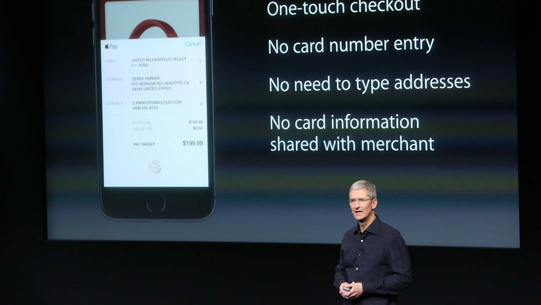 Apple CEO Tim Cook speaks about the Apple Pay service during a presentation at Apple headquarters.