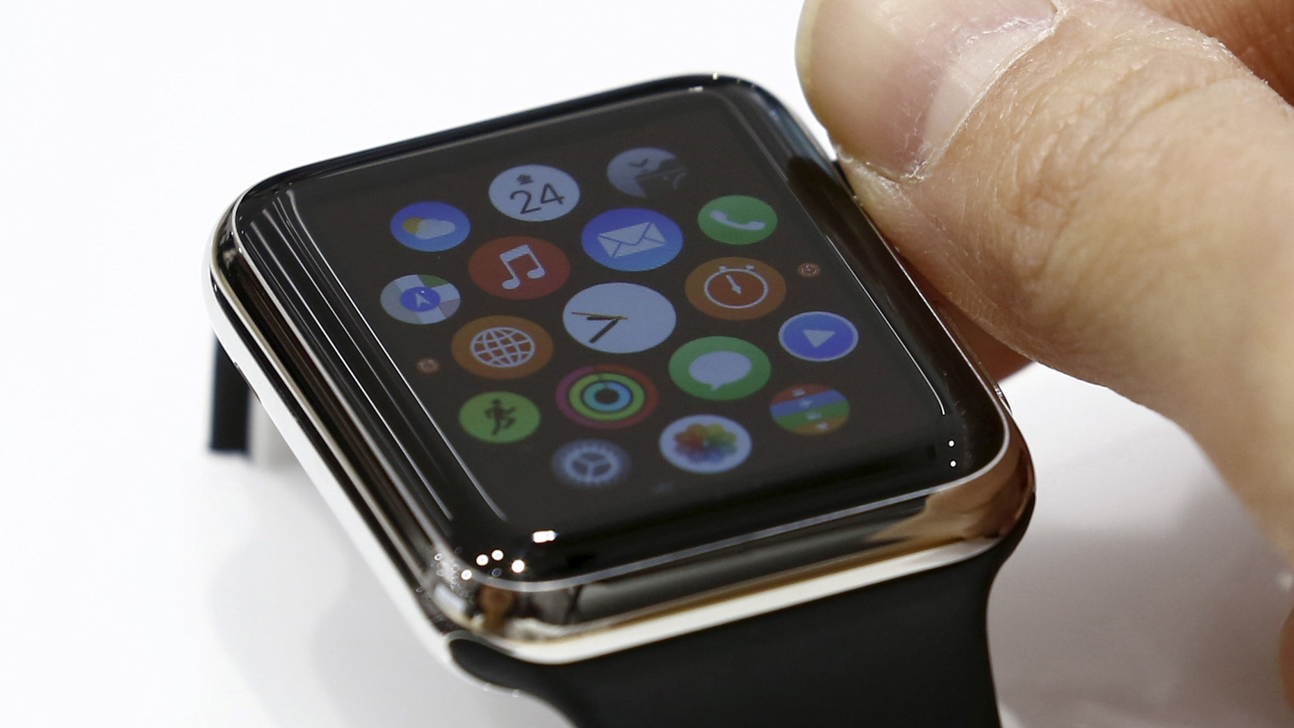 File photo - A woman uses Apple Watch that is on display at an electronics store in Omotasando in Tokyo April 24, 2015.