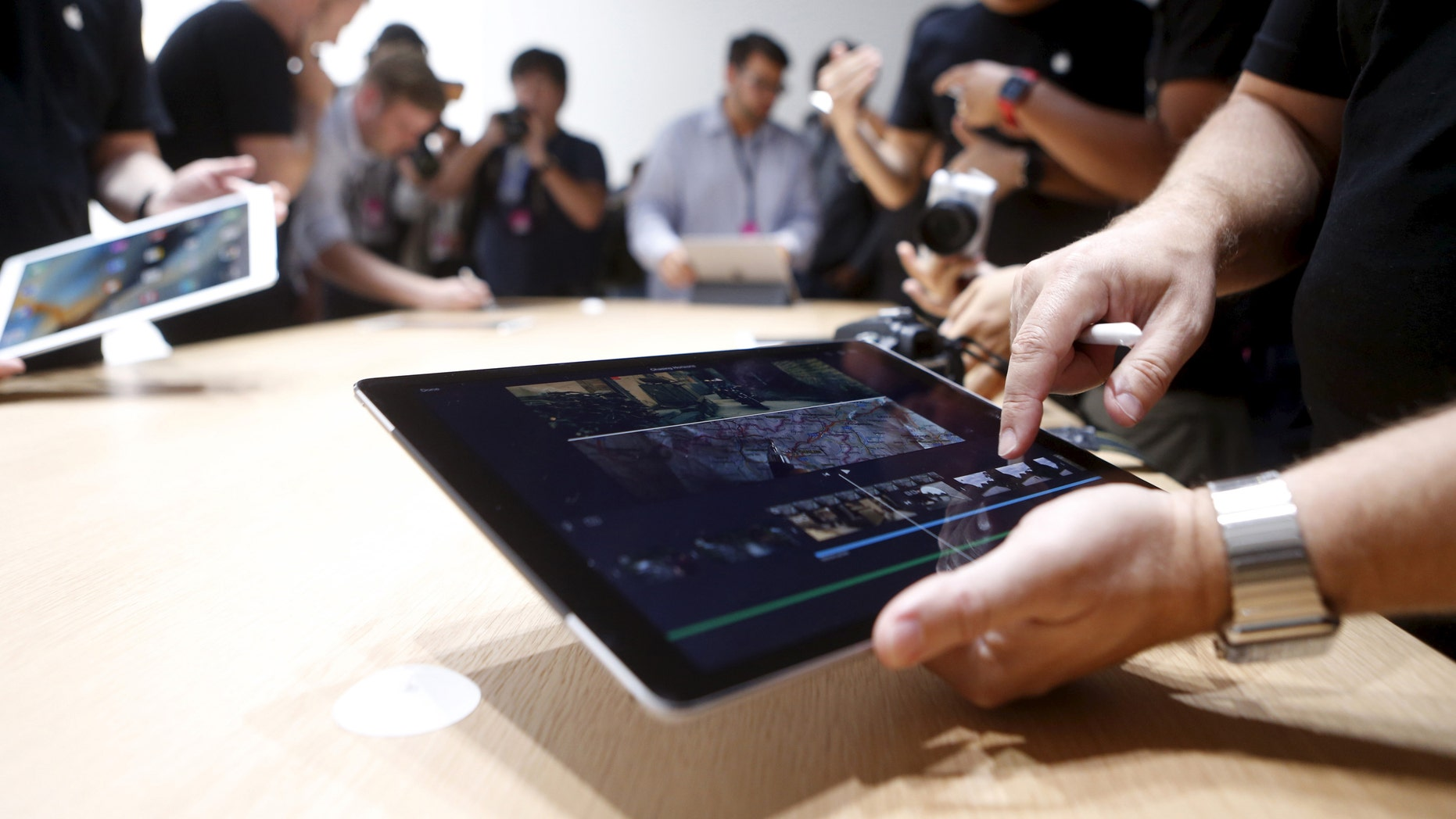 The new Apple iPad Pro is displayed during an Apple media event in San Francisco, Calif., Sept. 9, 2015.