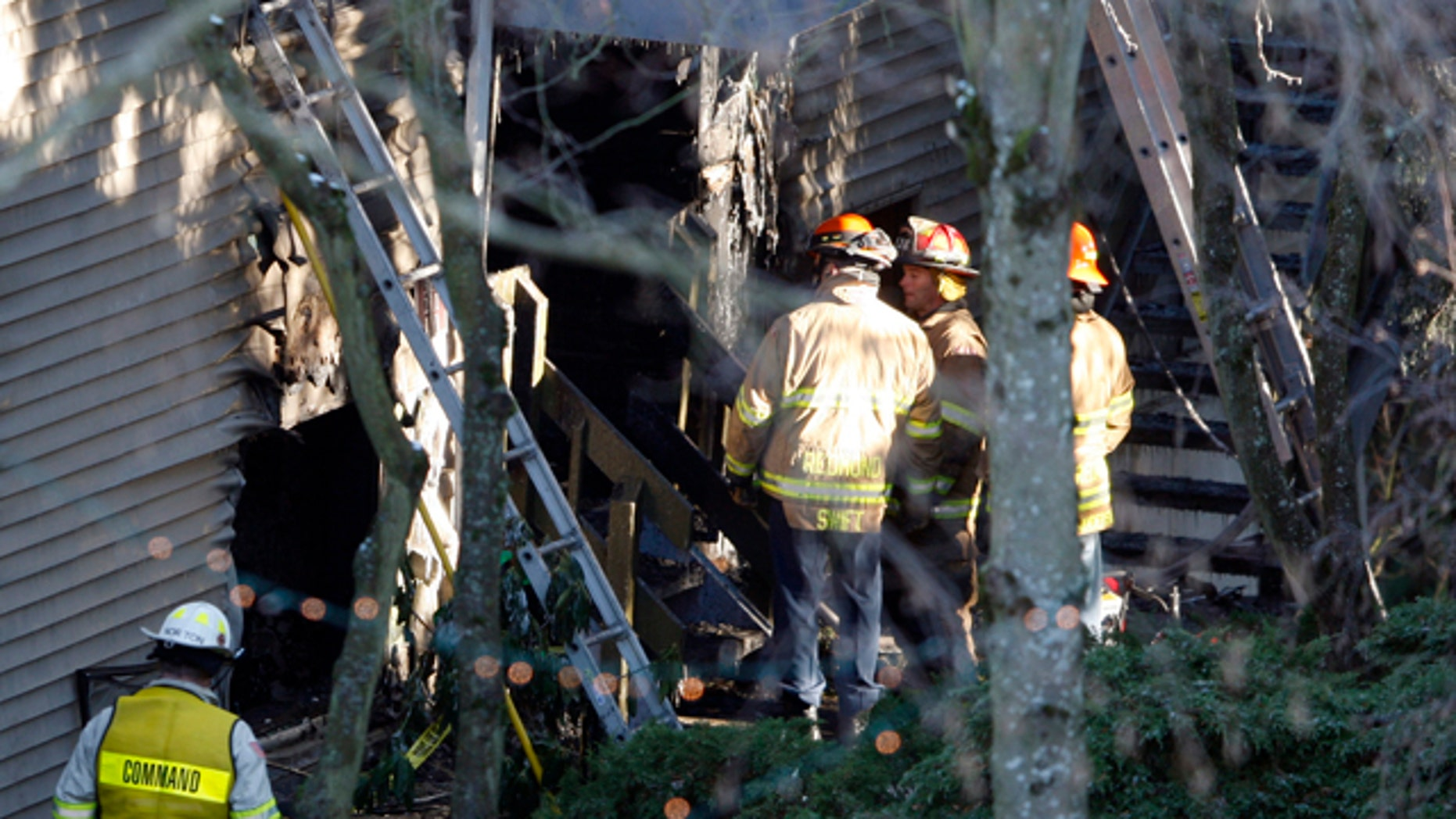 Jan. 1, 2011: Redmond firefighters and investigators insepct the scene of an apartment fire that claimed the lives of five people in Redmond, Wash.