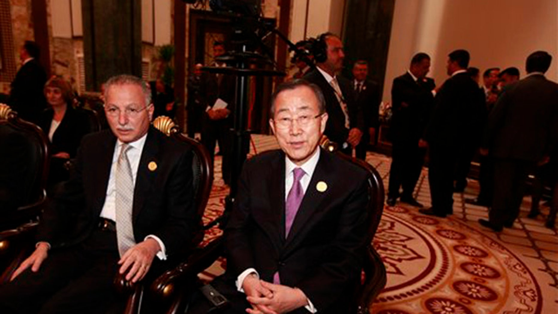 March 29, 2012: United Nations Secretary-General Ban Ki-moon, center, attends the Arab League summit in Baghdad, Iraq.