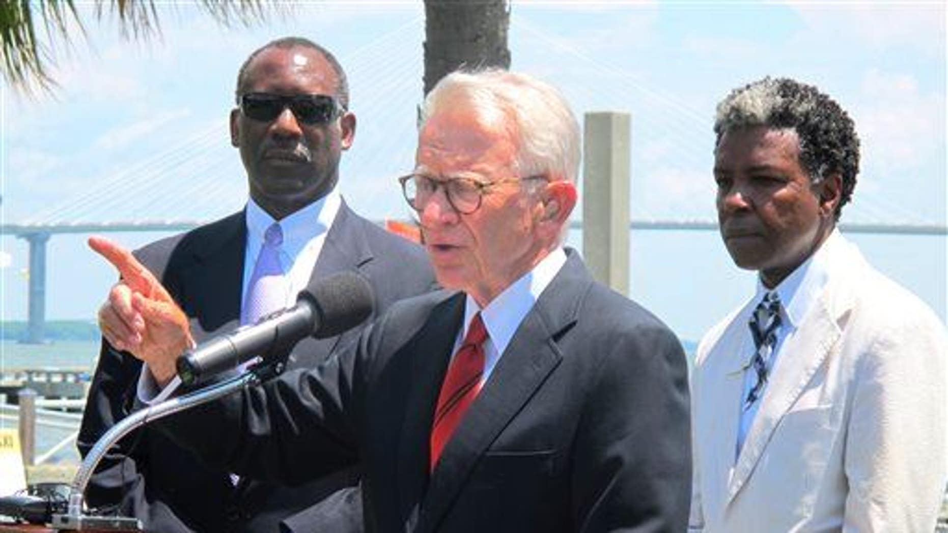 Mayor Joseph P. Riley Jr., center, announces the African American Museum to be built at the site of a wharf in Charleston, during a July 15, 2014 news conference in the city.