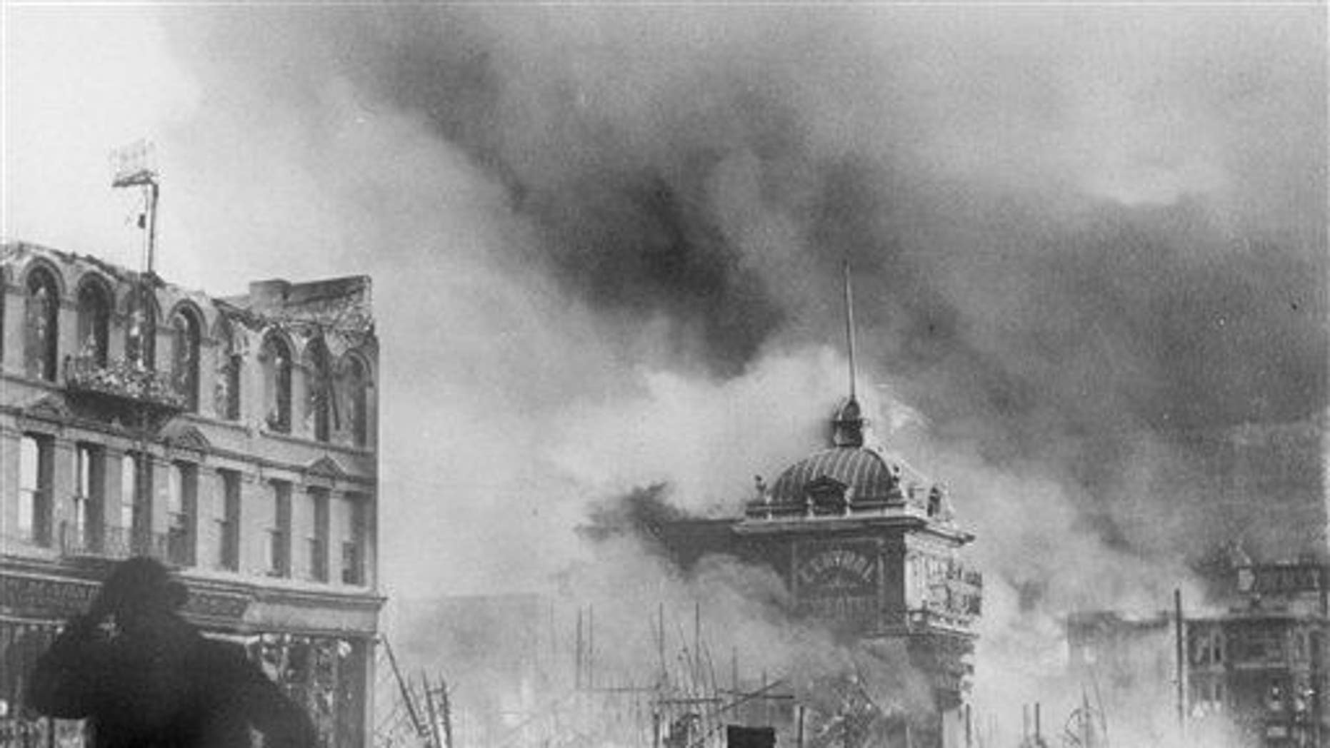 In this April 18, 1906 file picture, smoke rises from out-of-control fires following a powerful earthquake in San Francisco.