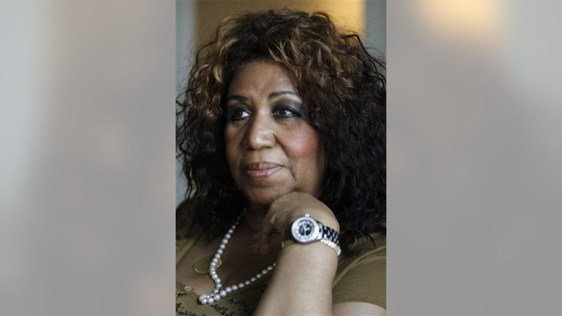 Performer Aretha Franklin is seen during an interview with the Associated Press in Philadelphia, Monday, July 26, 2010.  Former Secretary of State Condoleezza Rice and Franklin are scheduled to perform together Tuesday at the Mann Center for the Performing Arts in Philadelphia. (AP Photo/Matt Rourke)