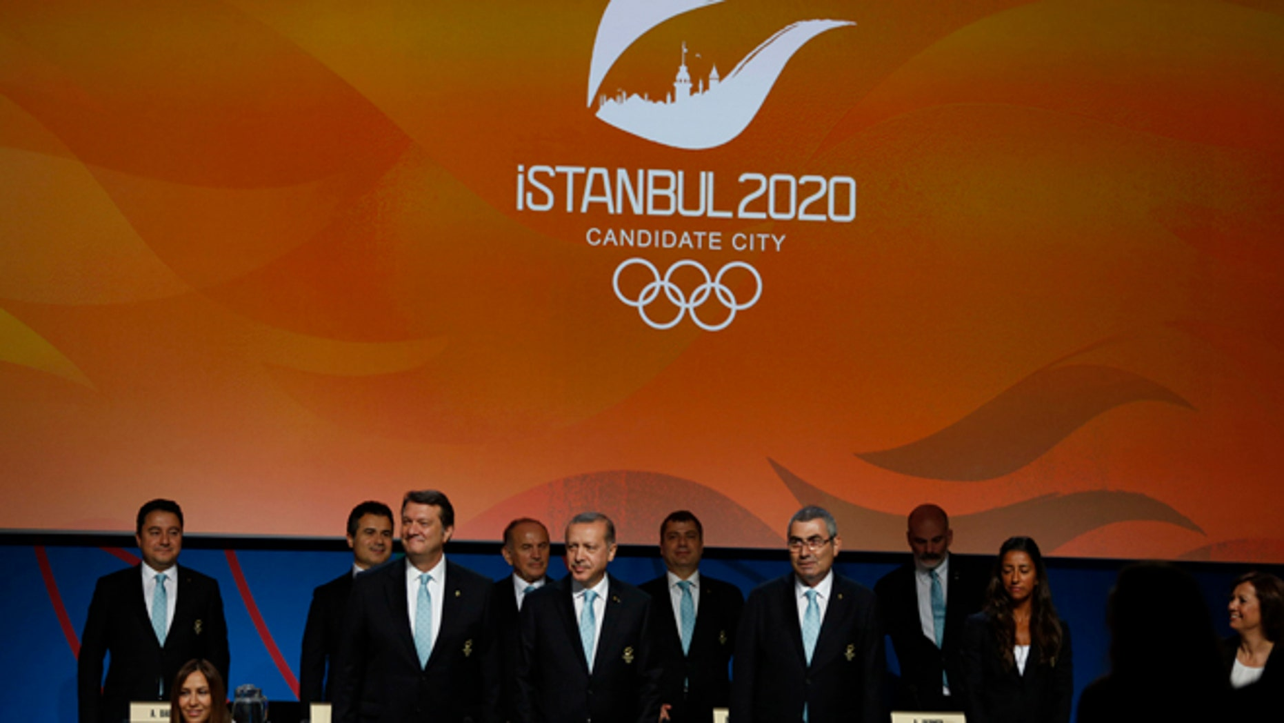 Turkey's delegation arrives to the Istanbul 2020 bid presentation during the International Olympic Committee session, Saturday, Sept. 7, 2013, in Buenos Aires, Argentina. Madrid, Istanbul and Tokyo are competing to host the 2020 Summer Olympic Games. (AP Photo/Natacha Pisarenko)