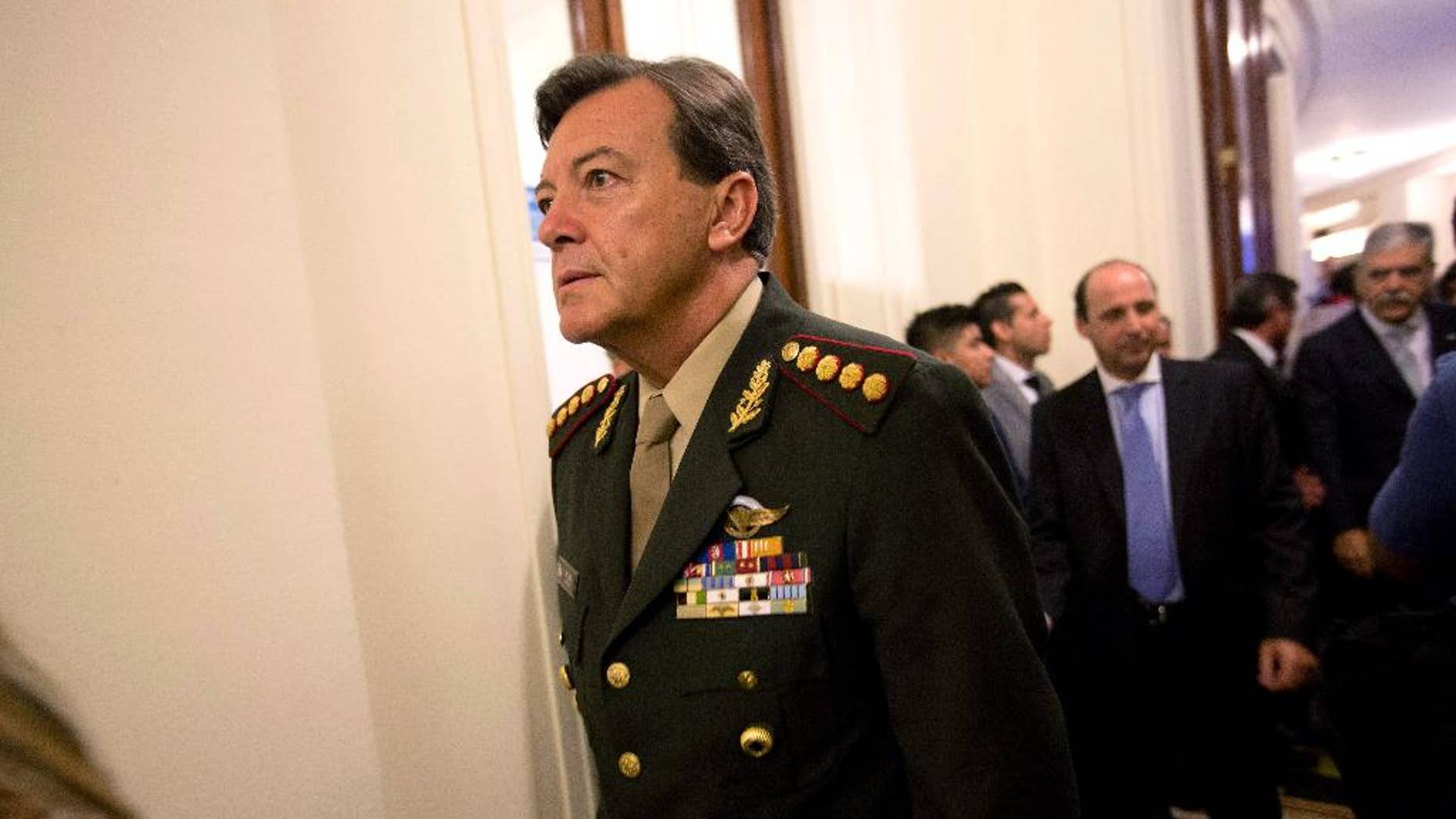 FILE - In this March 1, 2015 file photo, Gen. Cesar Milani arrives to Congress for the inauguration ceremony of the 2015 legislative year in Buenos Aires, Argentina. Milani, head of Argentina's army who's under investigation over his alleged role in the forced disappearance of a soldier during the country's 1976-1983 dictatorship, has asked for retirement on Tuesday, June 23, 2015. (AP Photo/Rodrigo Abd, File)