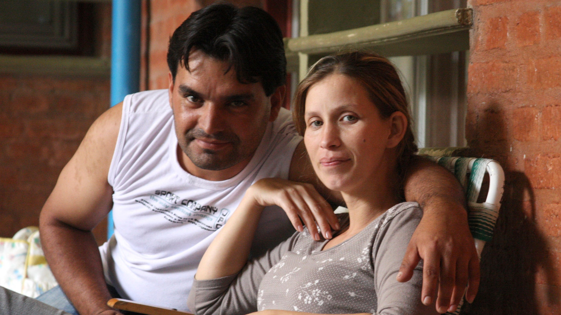 Analia Bouter and her husband Fabian Veron pose for a photo outside the hospital in Resistencia, Argentina, Wednesday April 11, 2012.  (AP Photo/Juan Pablo Faccioli)