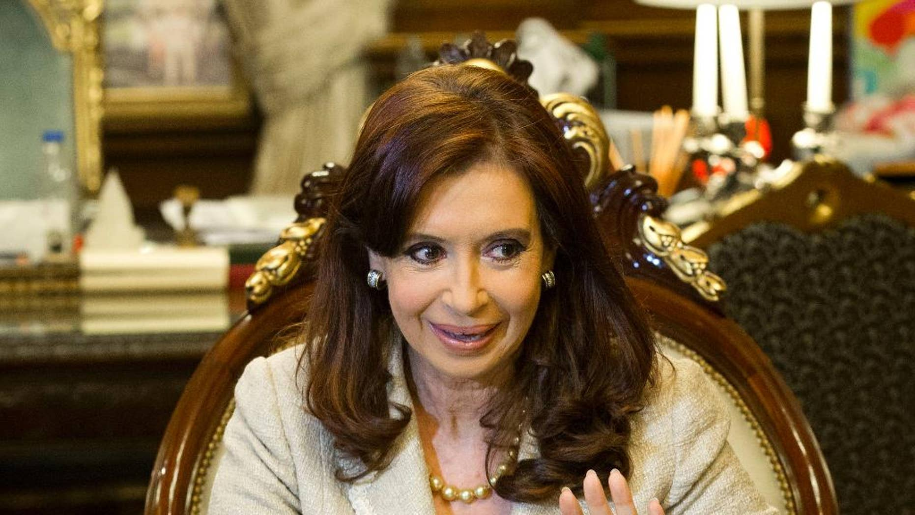 FILE - In this April 23, 2014 file photo, Argentine President Cristina Fernandez speaks during a meeting at Casa Rosada government palace in Buenos Aires, Argentina. Argentina's opponents filed their last arguments Wednesday, May 7, 2014, with the U.S. Supreme Court, urging justices to deny the South American government's appeal of a $1.4 billion debt ruling because Fernandez has repeatedly vowed not to honor any decision that goes against her. (AP Photo/Victor R. Caivano, File)
