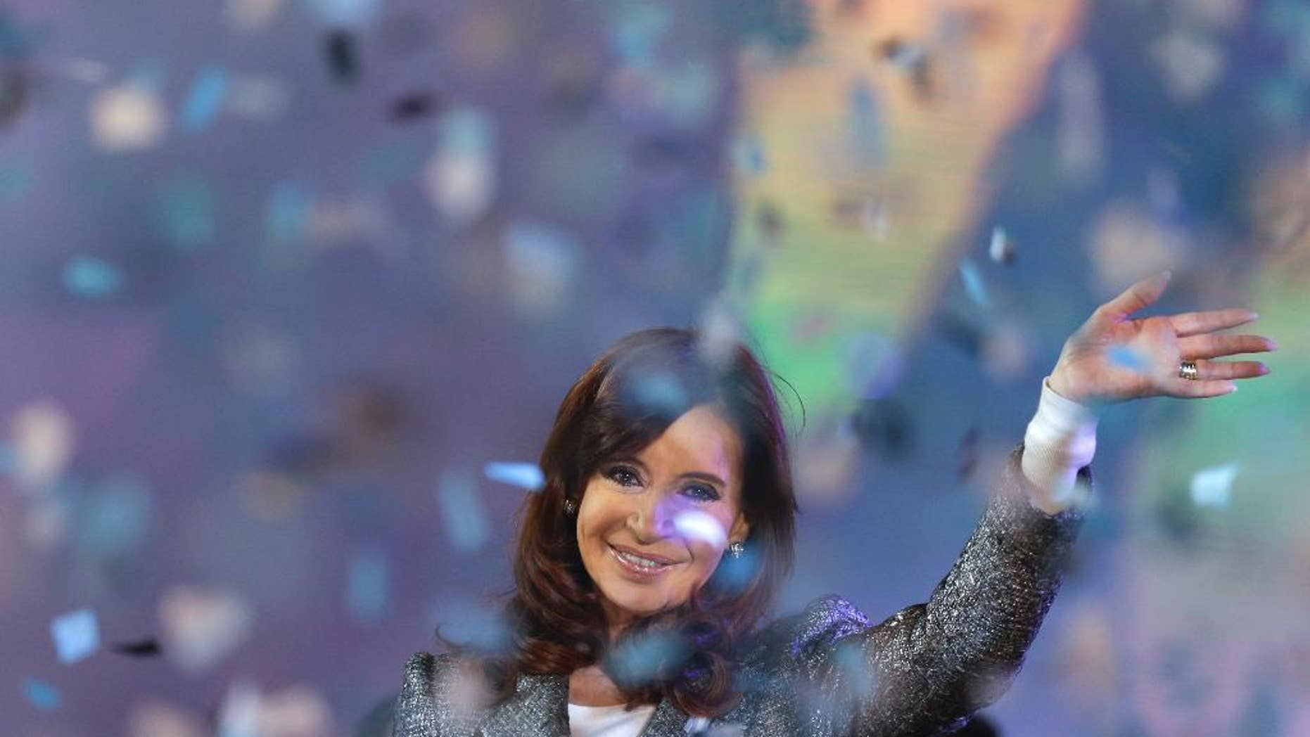 FILE - In this May 25, 2015, file photo, Argentina's President Cristina Fernandez smiles to supporters during the celebration of the 25 of May holiday at Plaza de Mayo in Buenos Aires, Argentina. It was announced Sunday, June 21, that Fernandez will not run for any public office once she leaves the presidency on December 10. (AP Photo/Natacha Pisarenko, File)