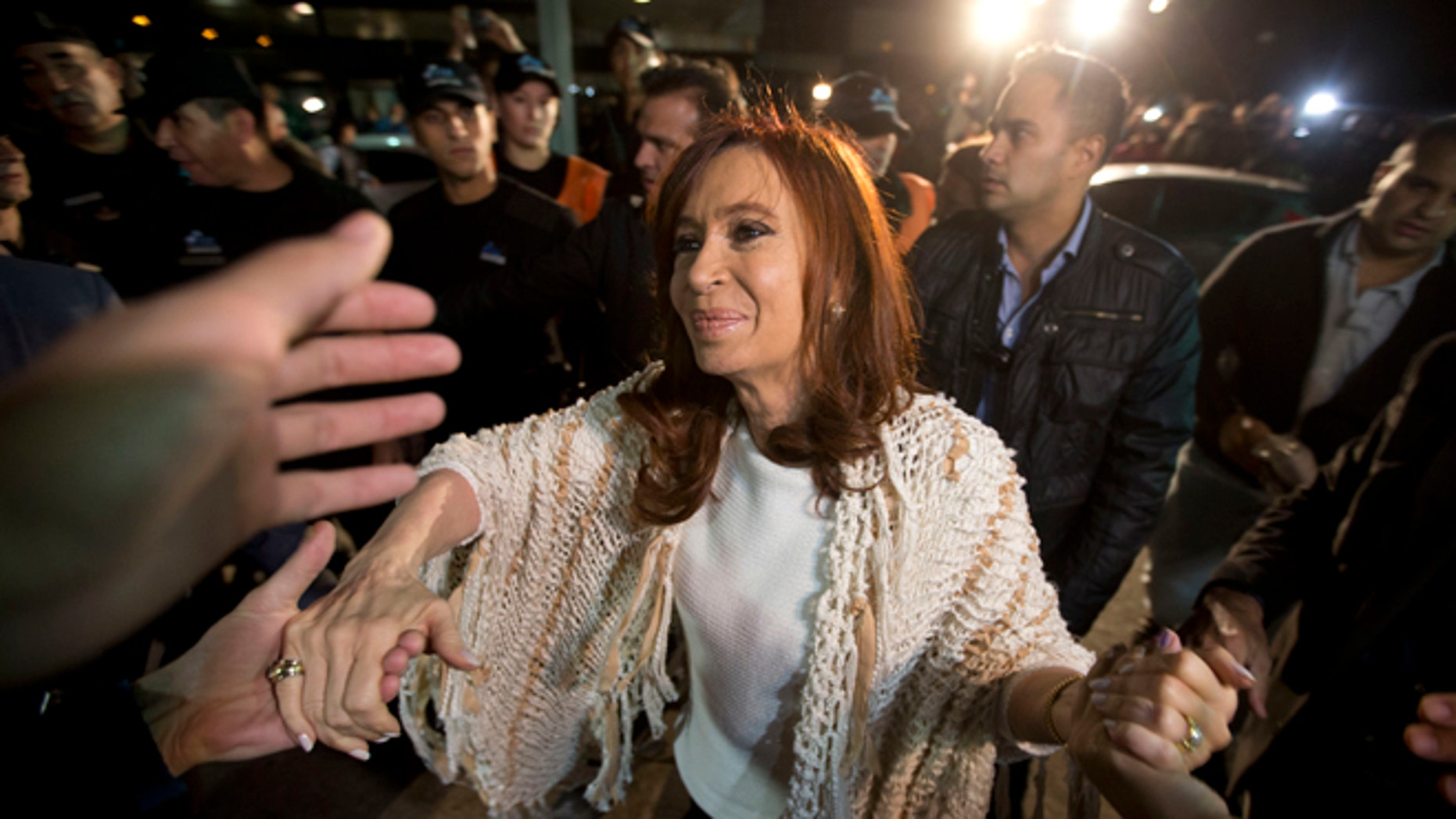 Cristina Fernandez greeted by followers in Buenos Aires, Argentina, Monday, April 11, 2016.