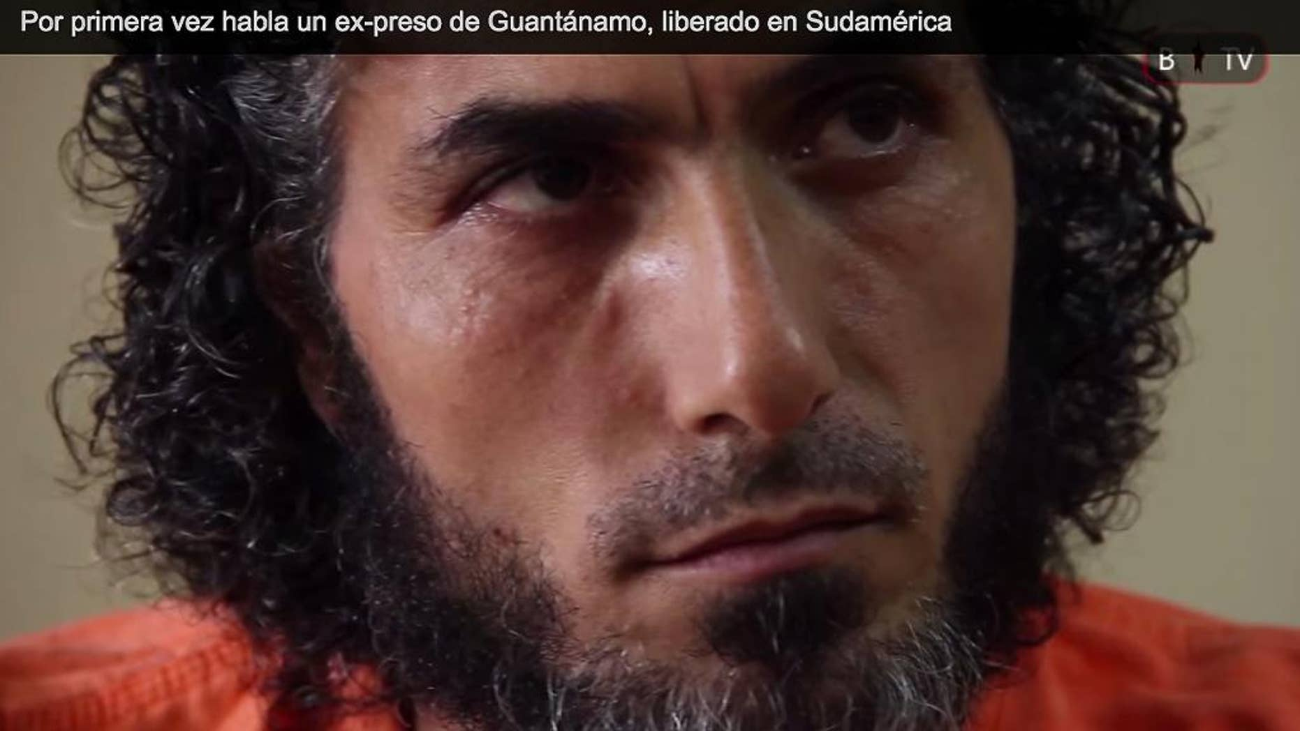 FILE - In this file photo of a frame grab from Barricada TV, recorded on Feb. 11, 2015, Abu Wa'el Dhiab, one of the Syrian refugees released from Guantanamo and now living in Uruguay, speaks during an interview, in Buenos Aires, Argentina. Dhiab, who led hunger strikes as a detainee and was resettled in Uruguay along with five other ex-inmates, is requesting a meeting with Uruguay's foreign minister to talk about the men's future. The men were resettled in Uruguay in December 2014. (AP Photo/Barricada TV, File)