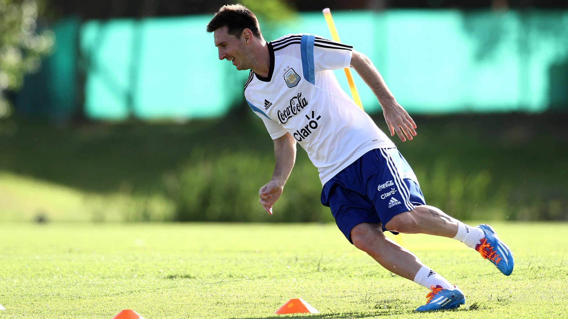 In this picture released by Argentina's Soccer Federation, Lionel Messi trains at Argentina's training facilities in the outskirts of Buenos Aires, Thursday, Dec. 5, 2013. Messi is in Argentina recovering from an injury. (AP Photo/Shu Kitayama,Argentina's Soccer Federation)
